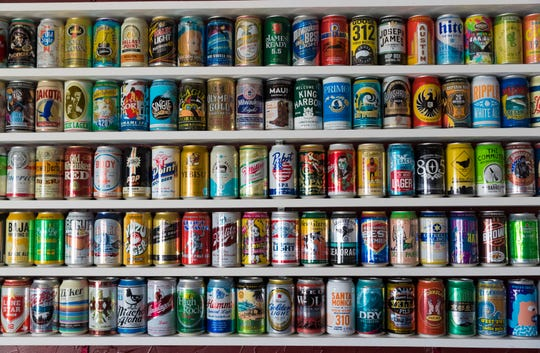 Jordon Bledsoe's beer can collection is part of the decor Tuesday, April 9, 2019 at his soon-to-open Trailer Park Tavern, 2989 S. Kinnickinnic Ave. in Milwaukee, Wis. The bar is to open in May.
