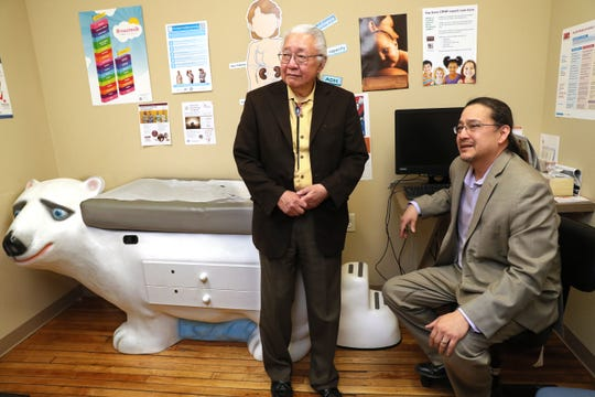 Physician Gerald Ignace with his son, physician Lyle Ignace in a pediatric exam room at the Gerald L. Ignace Indian Health Clinic on Milwaukee's south side. Gerald Ignace was a co-founder of the clinic in 1973.