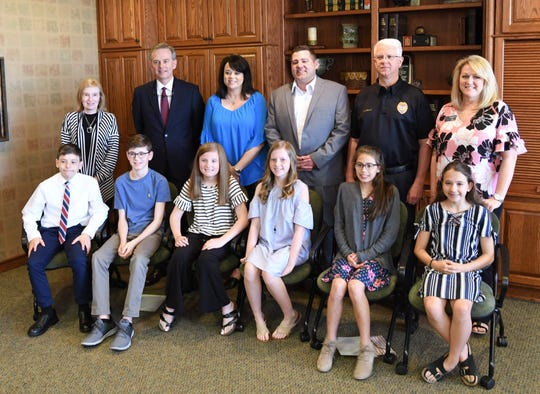 Sixth-grade students that shadowed City of Mountain Home officials earlier this week as part of the Kiwanis Club of Mountain Home's Student Government Day pose for a picture Wednesday afternoon.