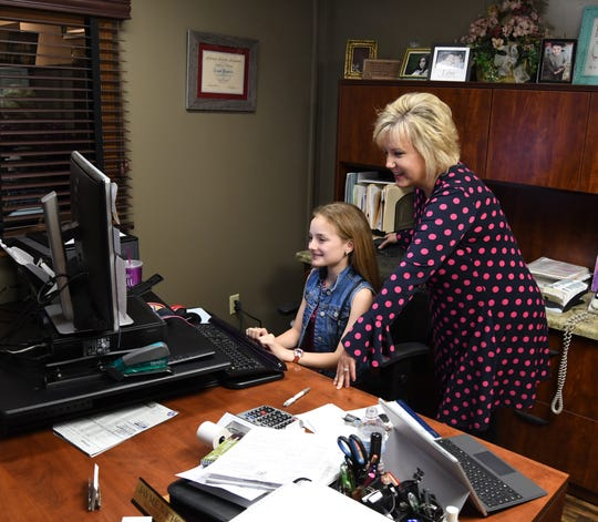 Karson Willie, a sixth-grader at Pinkston Middle School, sits at the desk of Baxter County Assessor Jayme Nicholson on Wednesday. Willie and 15 other students spent parts of Monday, Tuesday or Wednesday shadowing local officials to learn about their job duties.