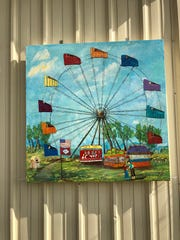 """""""Fair is Swell"""" is located at the Baxter County Fairgrounds. This block was painted by Margaret Stafford with the assistance of her husband Darrell, who has served on the Fair Board for 11 years. This was painted to honor all Baxter County residents who attend and volunteer at the fair, as well as the Fair Board members who work year around to make the Baxter County Fair one of the top county fairs in the state."""
