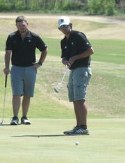Williams Baptist golfers watch a putt during Tuesday's final round of the Battle at Big Creek.