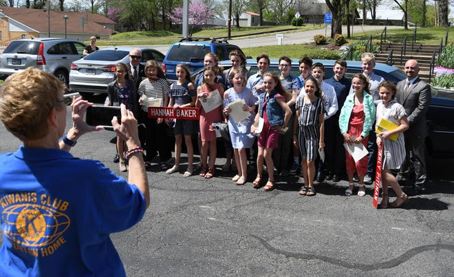 Kiwanis Club of Mountain Home member Jennifer Baker takes a group photo of the 16 Pinkston Middle School students participating in the Student Government Day program Wednesday.