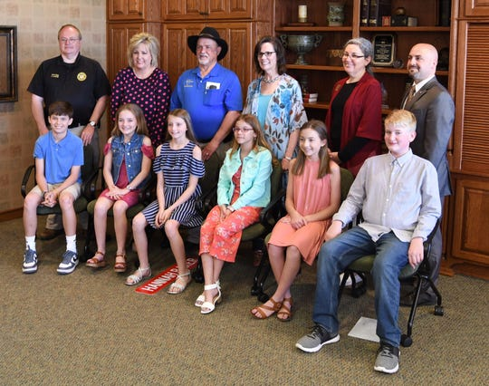 Pinkston Middle School students elected by their classmates to shadow county officials gather for a group photo Wednesday.