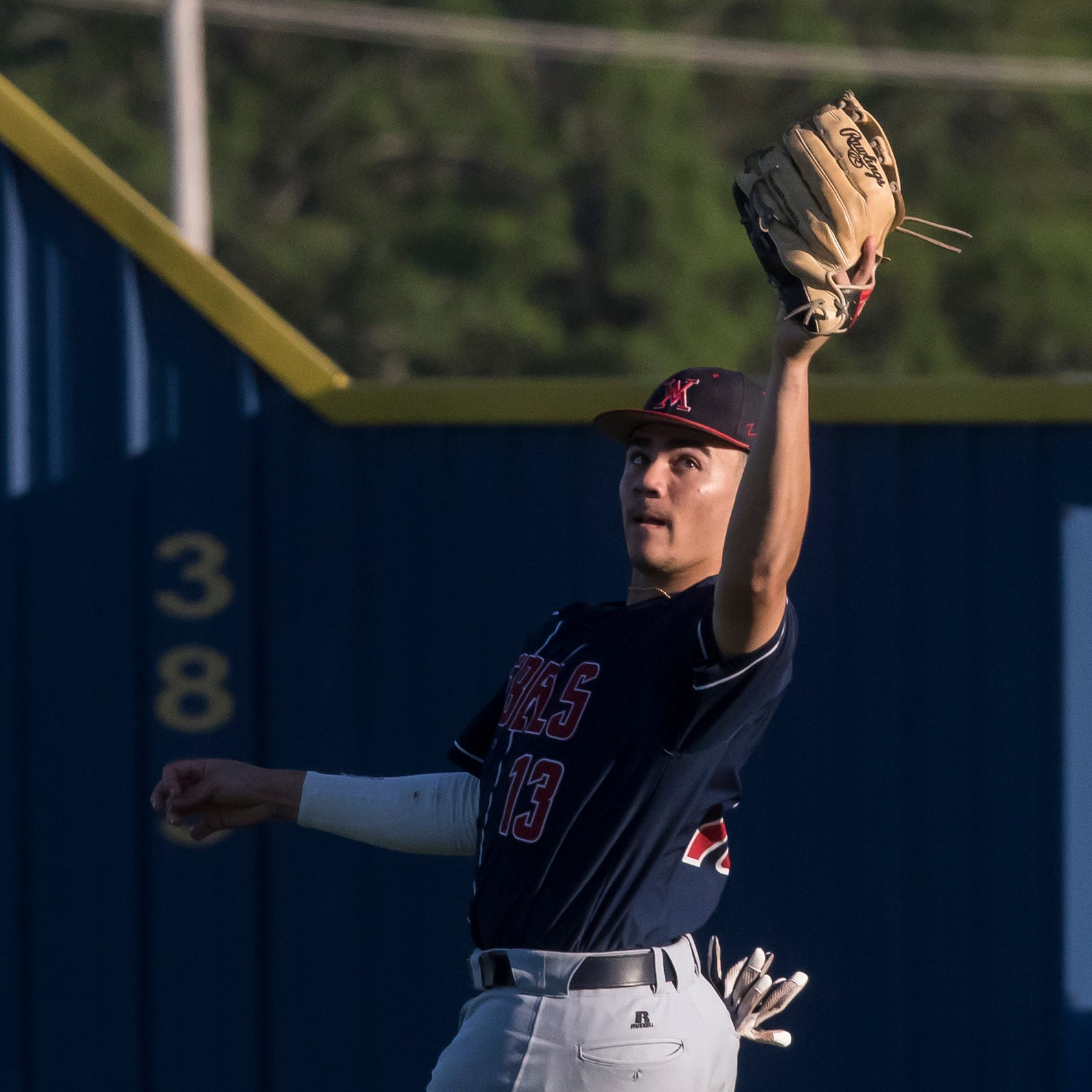 West Monroe's Cayden Pierce (13) makes a catch for the out in right field during the game in Sterlington, La. on April 9. Sterlington would go on to win the game 7-3.