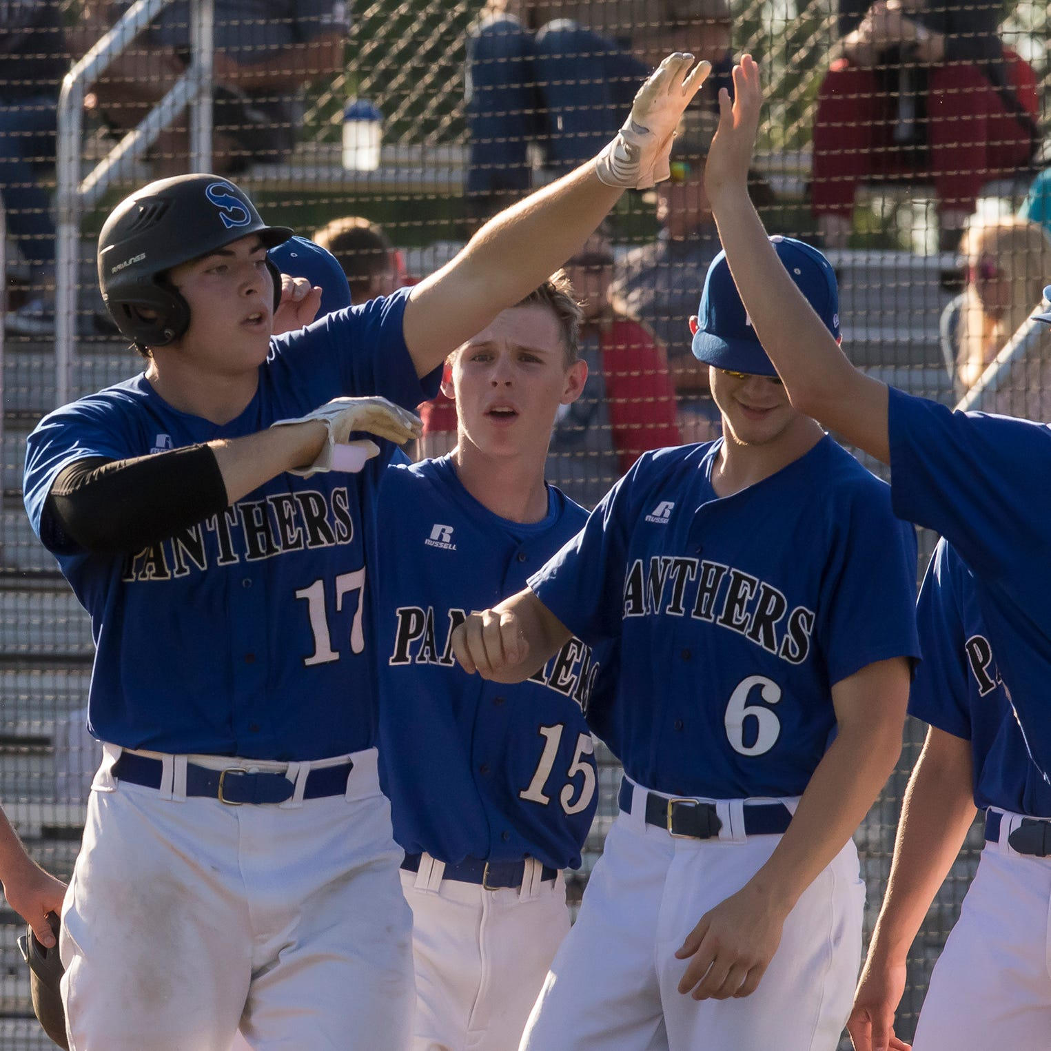 Sterlington's Trey Rugg (17) high fives his Panthers teammates after rounding the bases of his 3 run home-run to left field in the bottom of the 4th inning during the game against West Monroe High School in Sterlington, La. on April 9. Sterlington would go on to win the game 7-3.