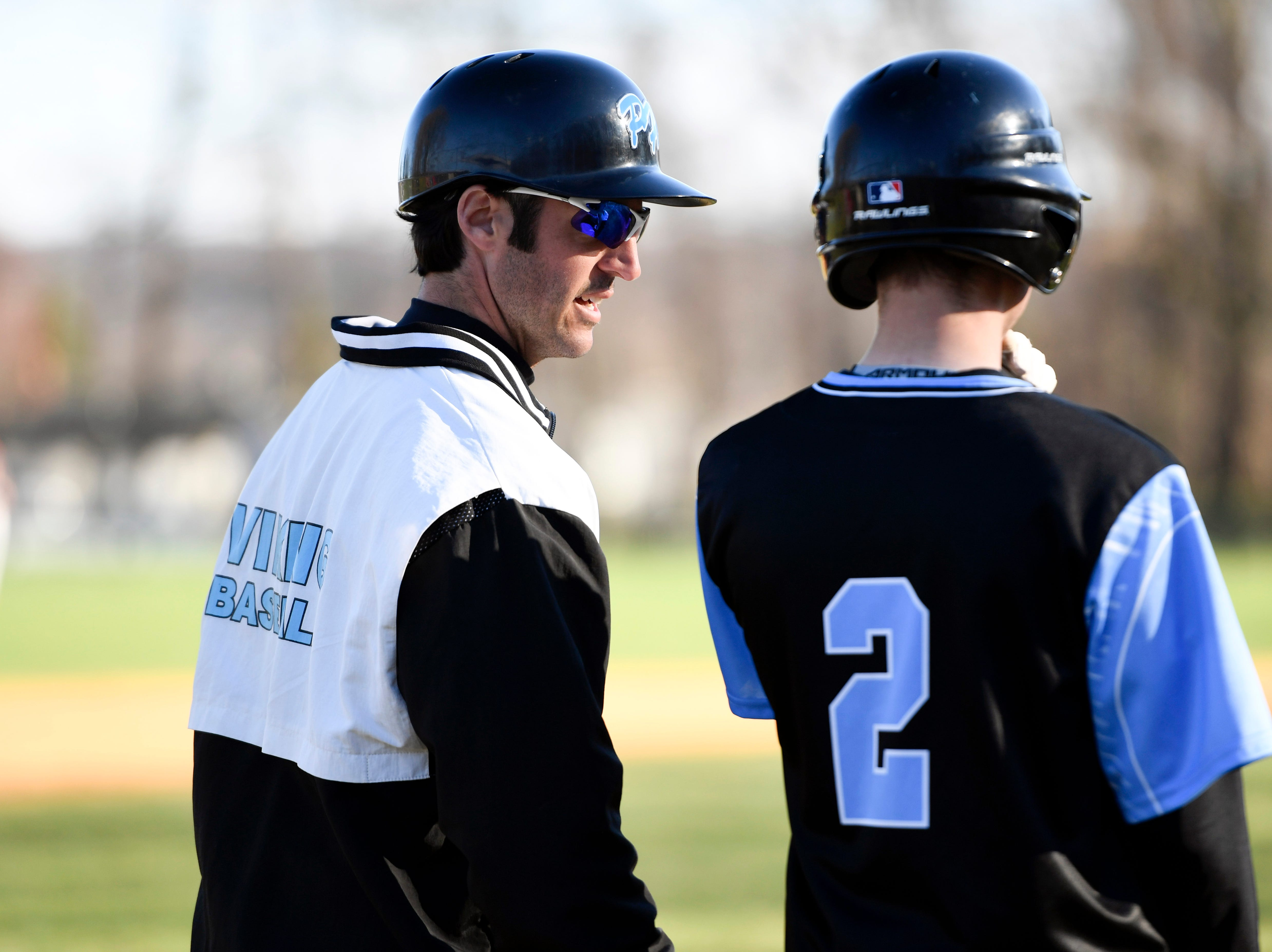 Parsippany Hills head coach Pete Anzelone talks to Paul Kievit (2) during a game against Morris Hills on Wednesday, April 10, 2019, in Rockaway.