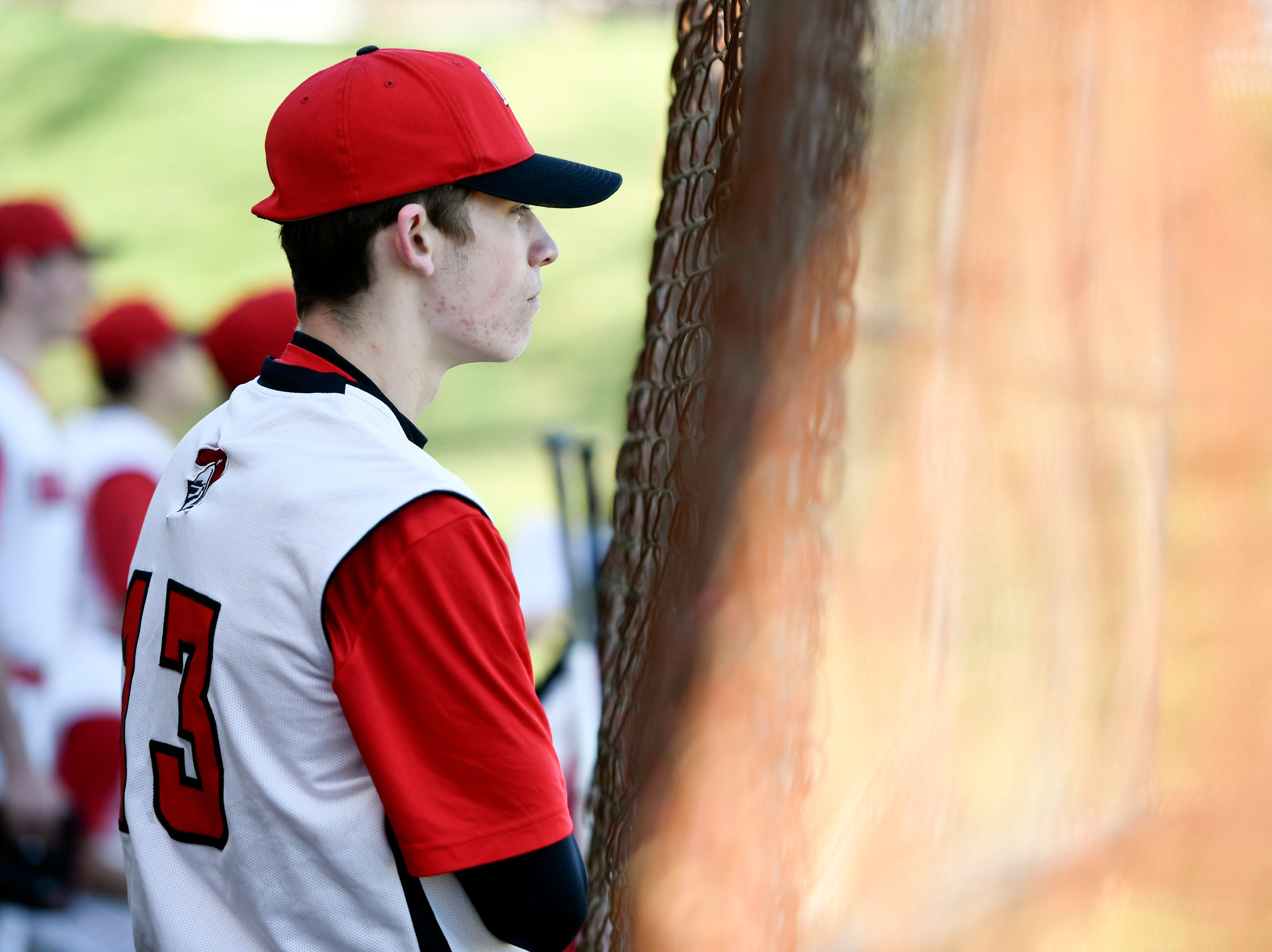 Morris Hills' Aidan Ruanne watches from the bench as his team plays Parsippany Hills on Wednesday, April 10, 2019, in Rockaway.