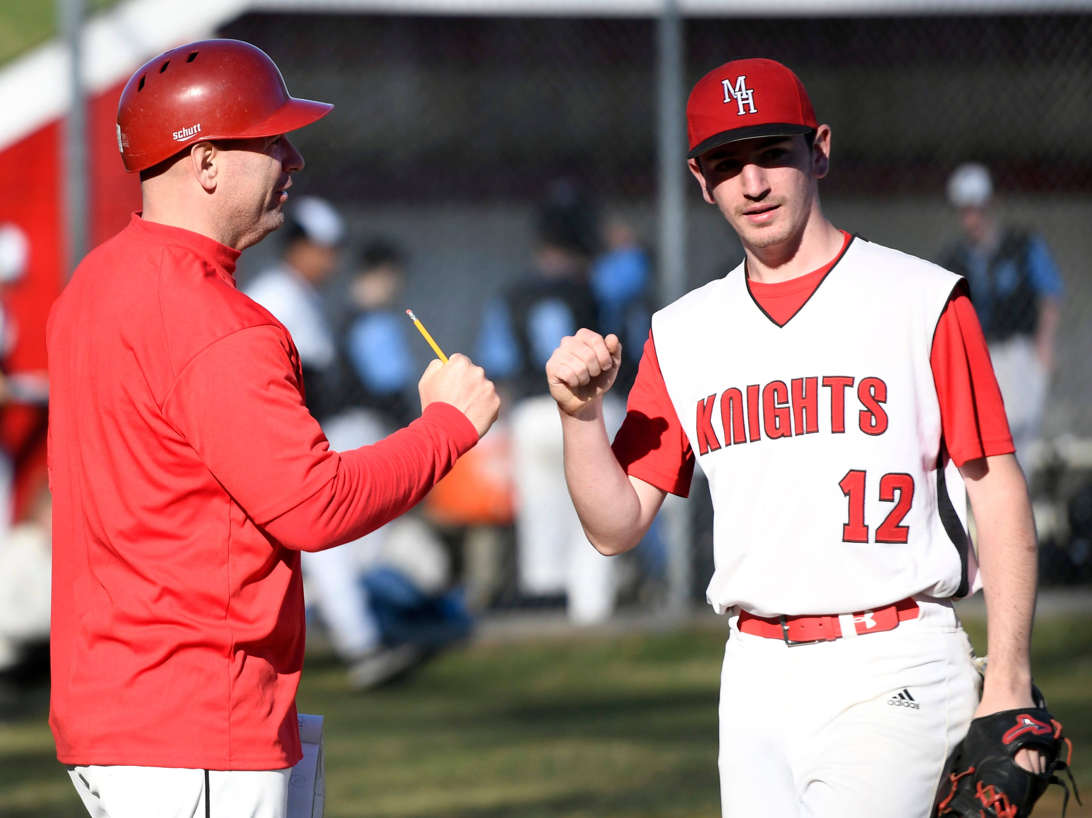 Morris Hills head coach Bert Giovine fist-bumps Jack Sautter during a game against Parsippany Hills on Wednesday, April 10, 2019, in Rockaway.