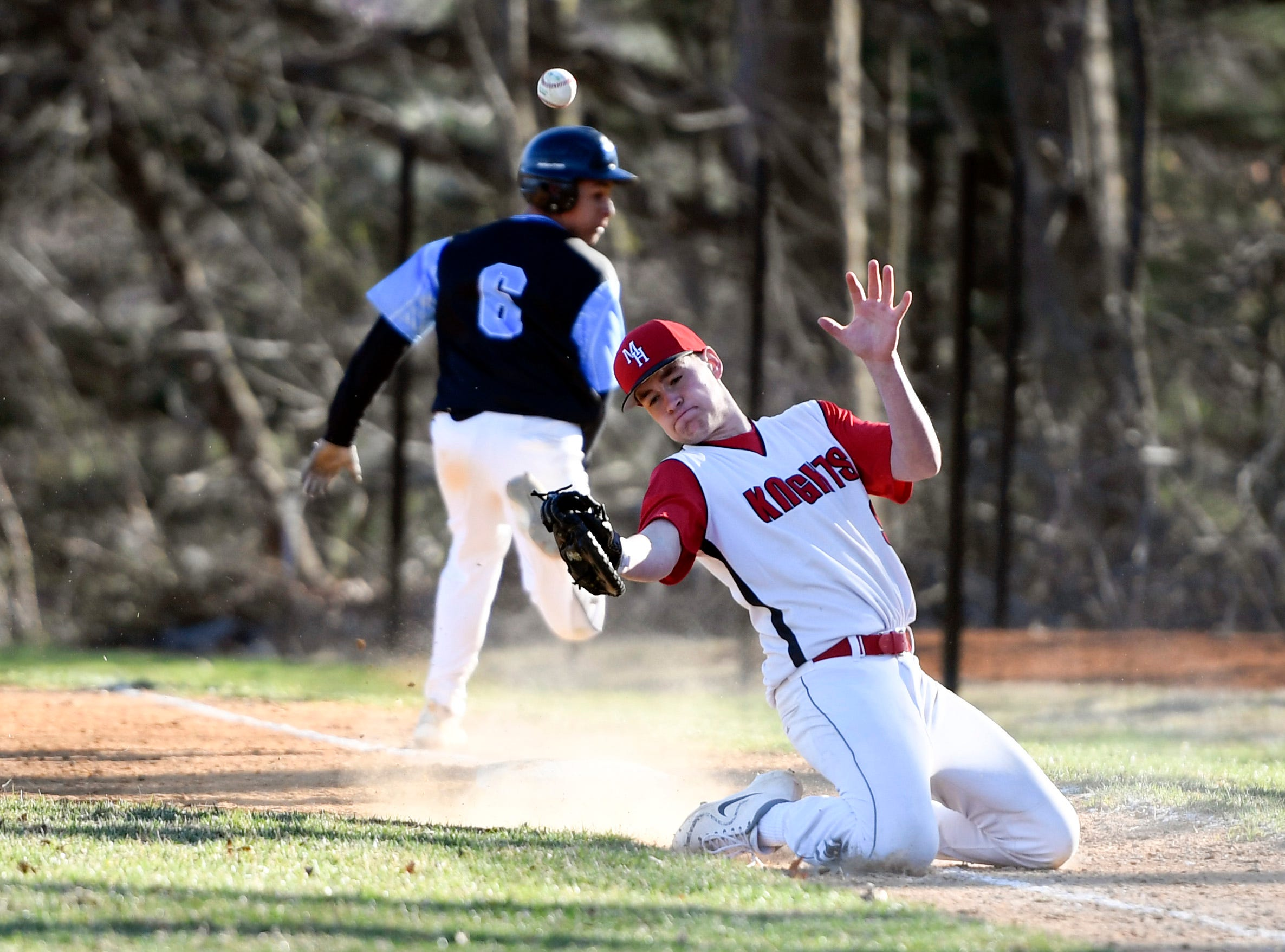 Parsippany Hills runner Ty Sallie (6) looks back as Morris Hills' Gary Toscano misses a wild throw to first on Wednesday, April 10, 2019, in Rockaway.