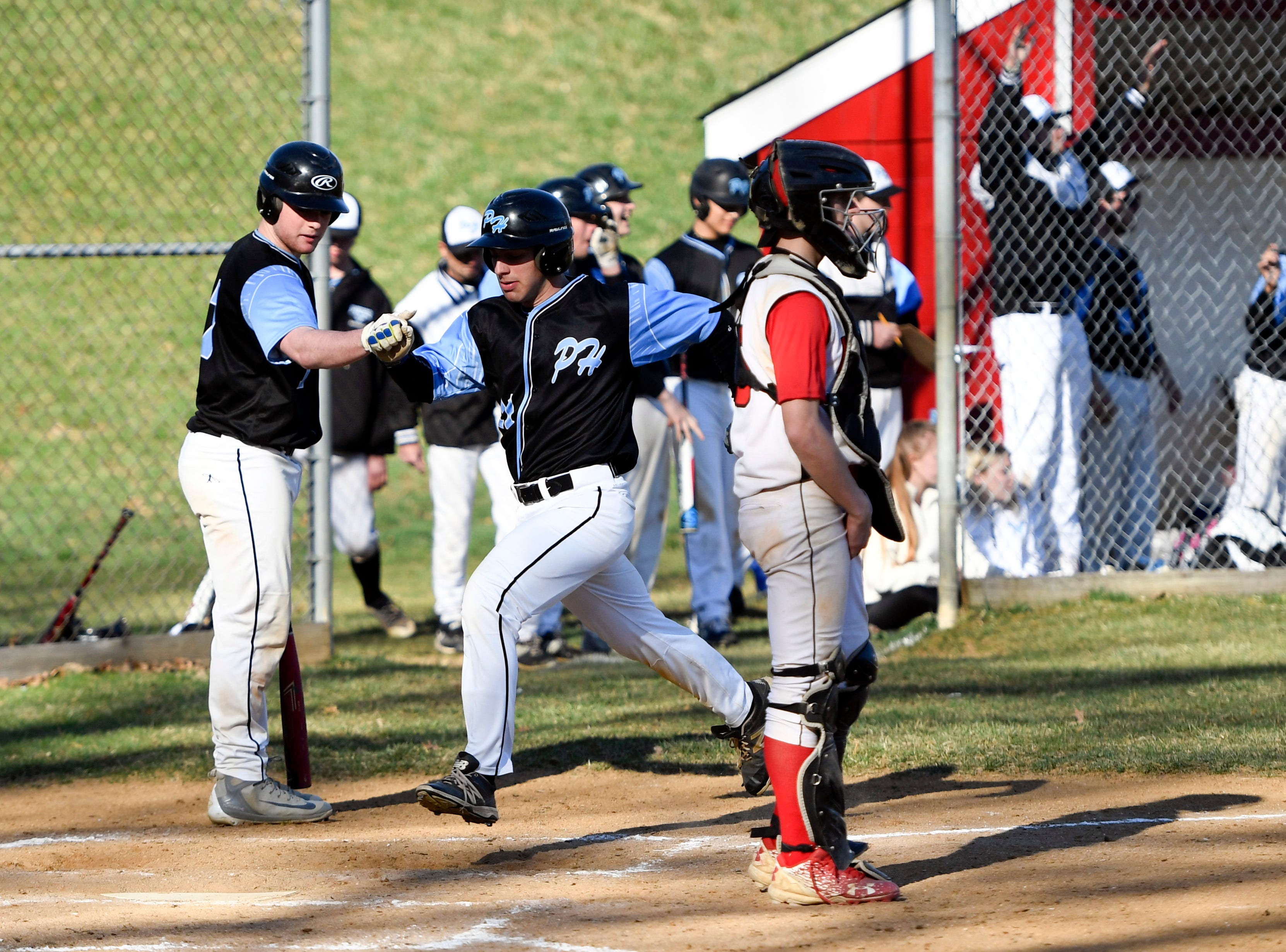 Parsippany Hills' Nick Chraca scores a run against Morris Hills on Wednesday, April 10, 2019, in Rockaway.