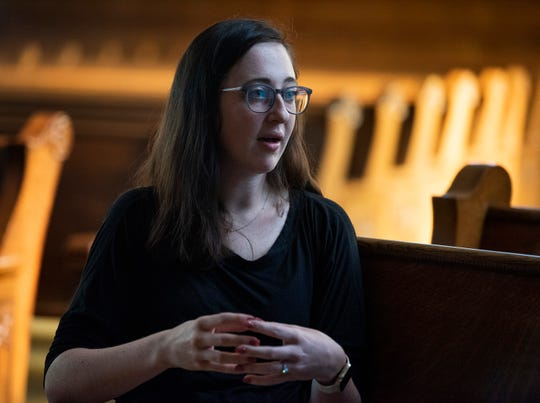 Jessie Jacobs talks about the historic First Presbyterian Church building in Montgomery, Ala., which houses ministries from First Baptist Church, on Wednesday April 10, 2019.