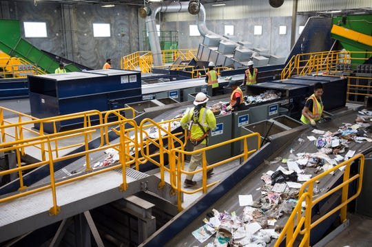 Workers sort through recyclables at a quality control area at the recently renovated RePower South recycling facility in Montgomery, Ala., on Wednesday, April 10, 2019.