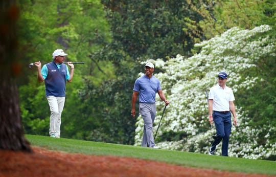 Apr 8, 2019; Augusta, GA, USA; Fred Couples , Tiger Woods and Justin Thomas walk down the fairway on the 11th hole during a practice round for the Masters golf tournament at Augusta National Golf Club. Mandatory Credit: Rob Schumacher-USA TODAY Sports