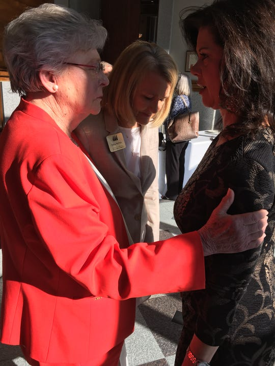 Gov. Kay Ivey, left, talks to Alabama Power Vice President Leslie Sanders, right, and Montgomery Area Chamber of Commerce Senior Vice President Ellen McNair after a speech Wednesday in downtown Montgomery.