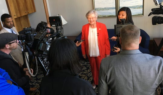 Gov. Kay Ivey speaks to the media after a speech Wednesday in downtown Montgomery.