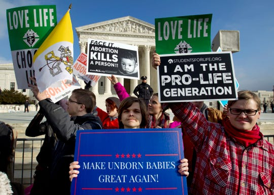 FILE - In this Jan. 18, 2019, file photo, anti-abortion activists protest outside of the U.S. Supreme Court, during the March for Life in Washington. Emboldened by the new conservative majority on the Supreme Court, anti-abortion lawmakers and activists in numerous states are pushing near-total bans on the procedure in a deliberate frontal attack on Roe v. Wade. (AP Photo/Jose Luis Magana, File)