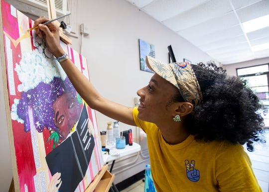 Saquin Evans paints in The King's Canvas art space in Montgomery, Ala., on Wednesday April 10, 2019.
