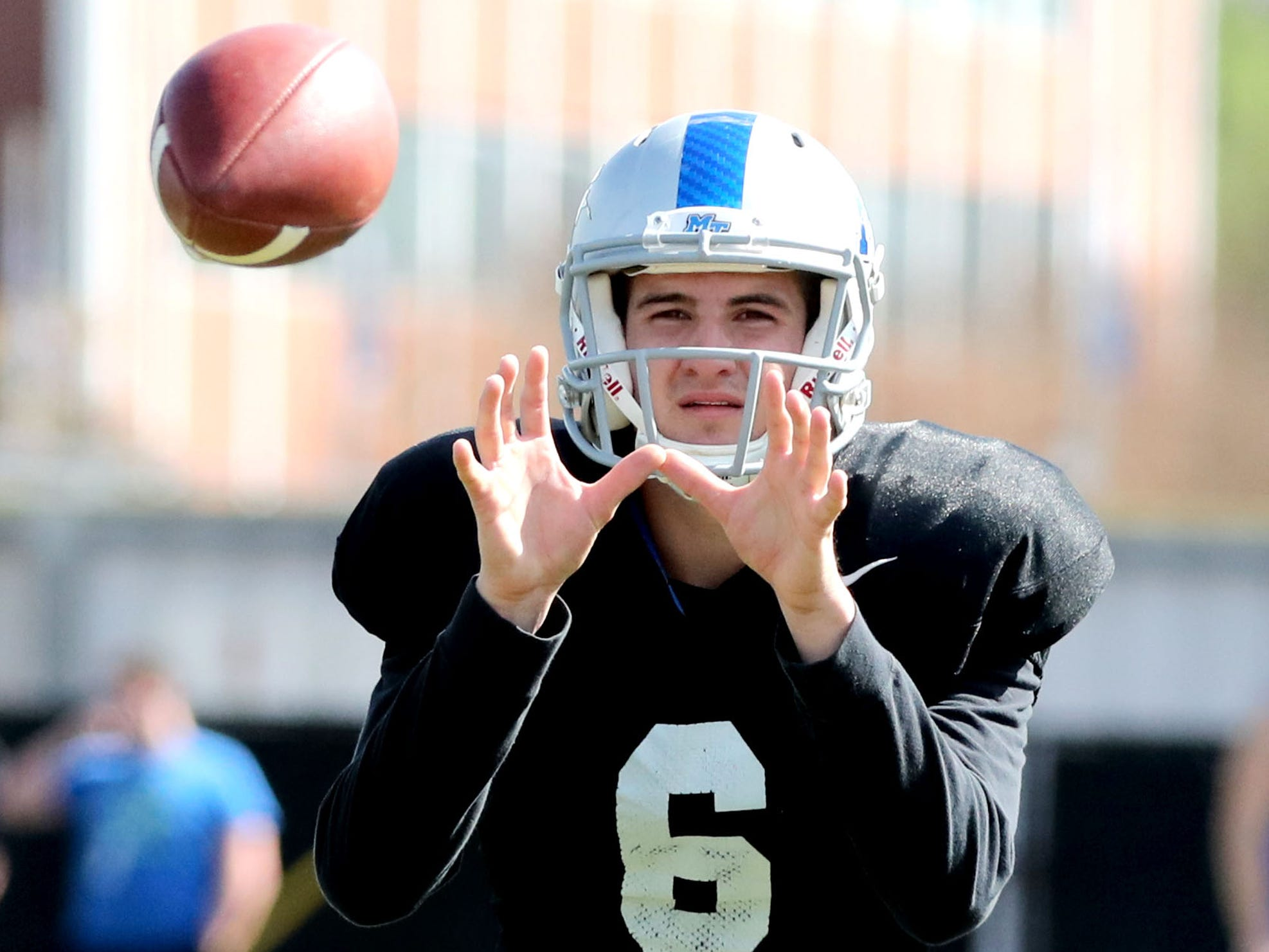 MTSU's quarterback Chance Nolan (6) waits for the snap to catch the ball and pass during MTSU's football practice, in Murfreesboro on Tuesday April 9, 2019.
