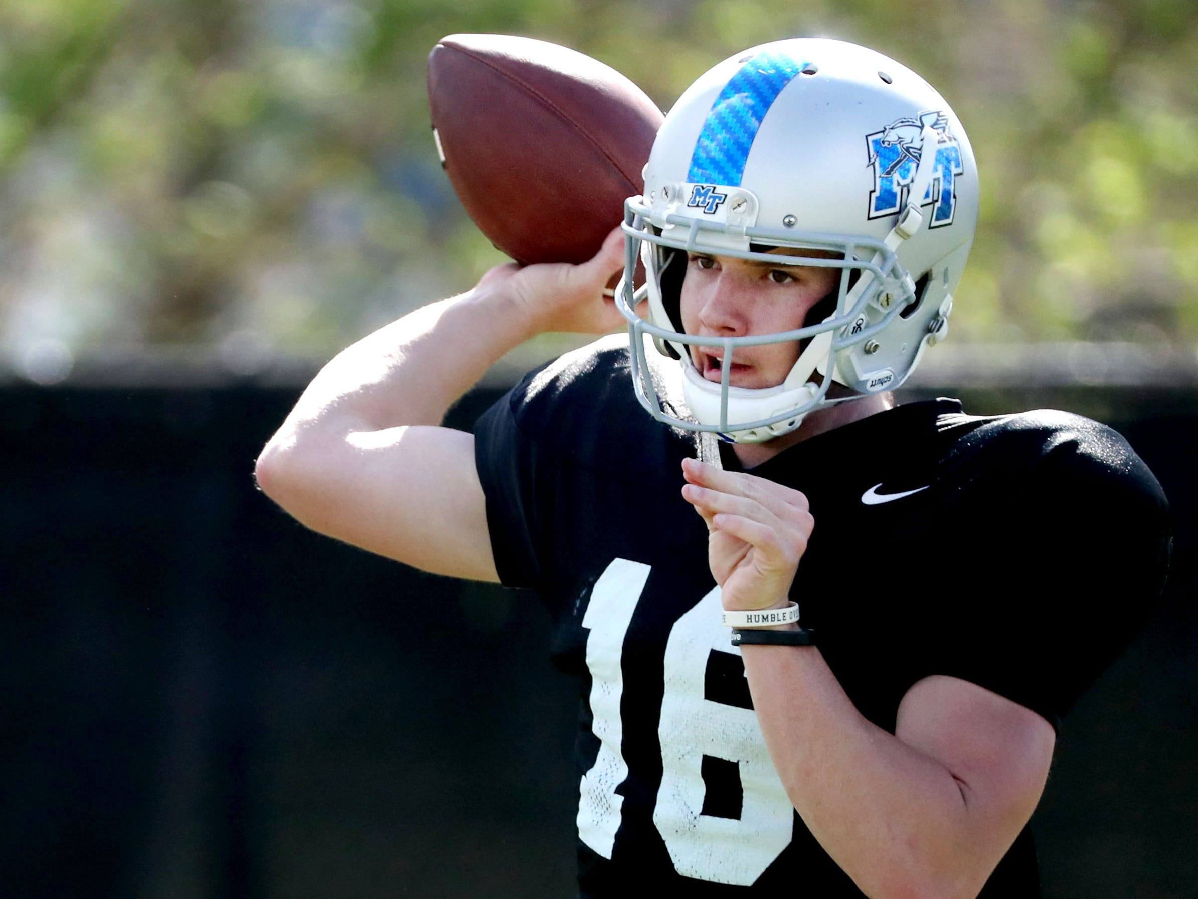MTSU's quarterback Chase Cunningham (16) passes the ball during MTSU's football practice, in Murfreesboro on Tuesday April 9, 2019.