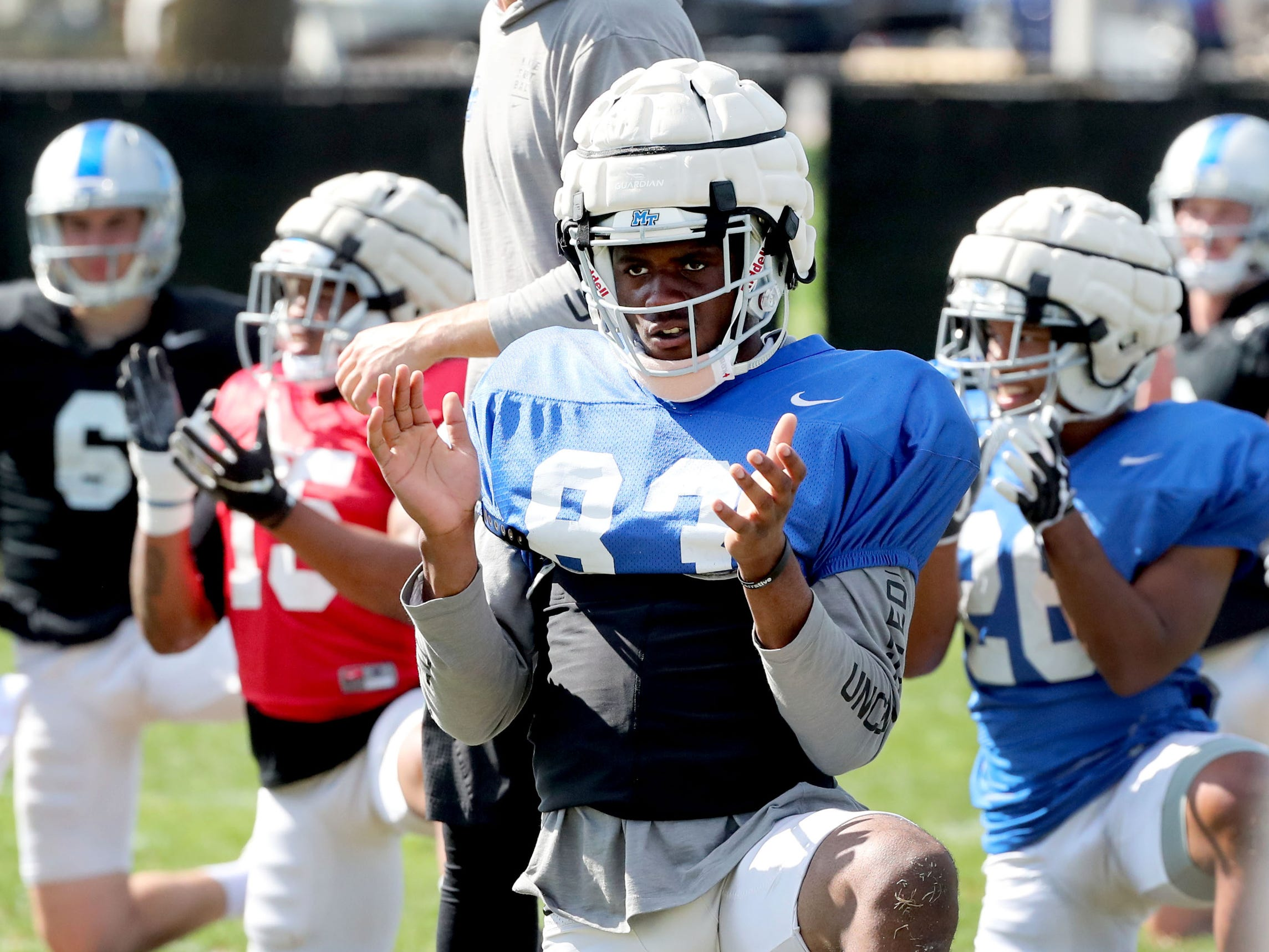 MTSU's wide receiver Jimmy Marshall (83) warms up during MTSU's football practice, in Murfreesboro on Tuesday April 9, 2019.