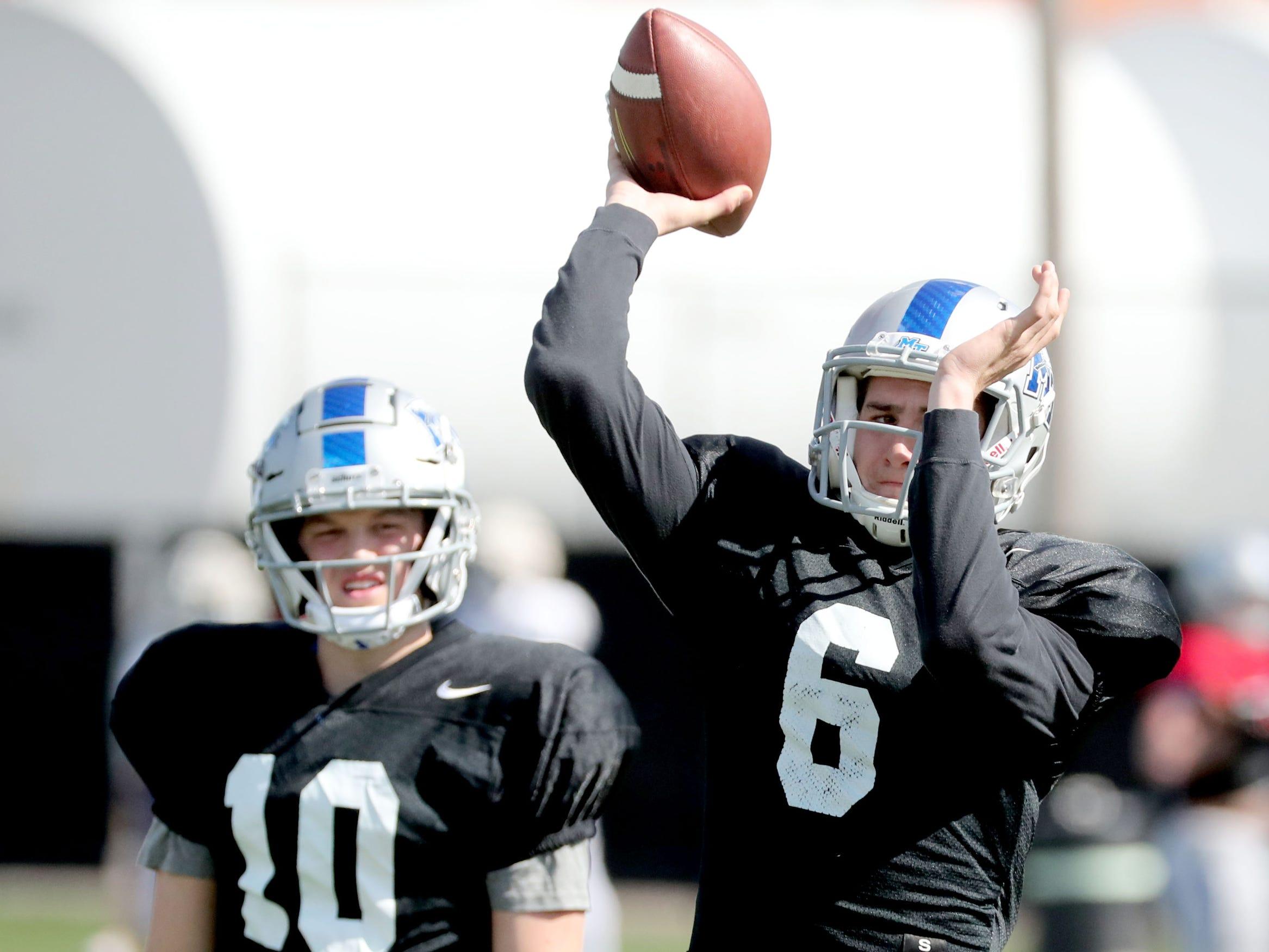 MTSU's quarterback Asher O'Hara (10) watches as MTSU's quarterback Chance Nolan (6) passes the ball during MTSU's football practice, in Murfreesboro on Tuesday April 9, 2019.