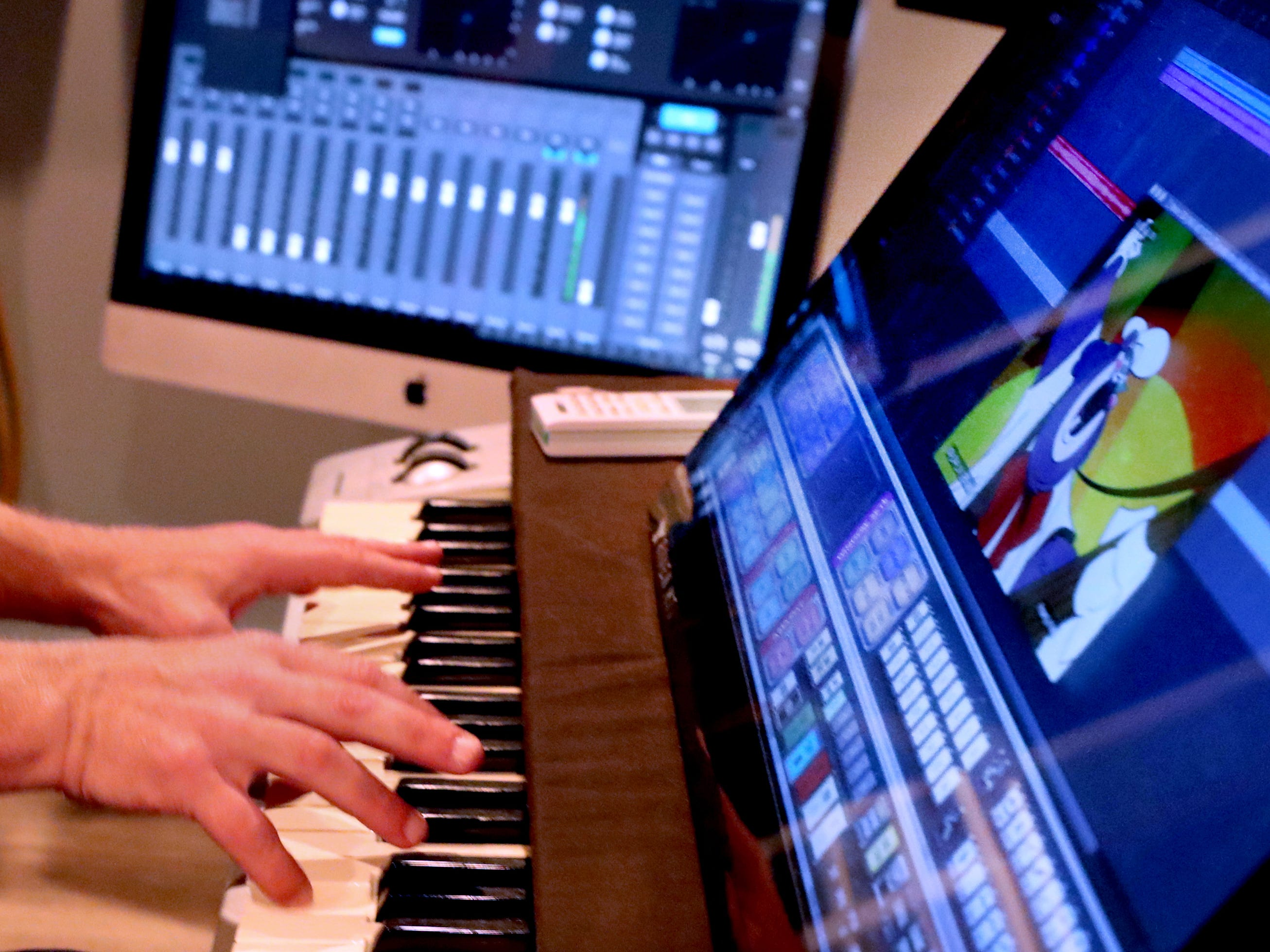 Andy Harper shows how he can score music to a particular track of video or animation in his studio Limitedwave Recordings on Wednesday April 10, 2019.