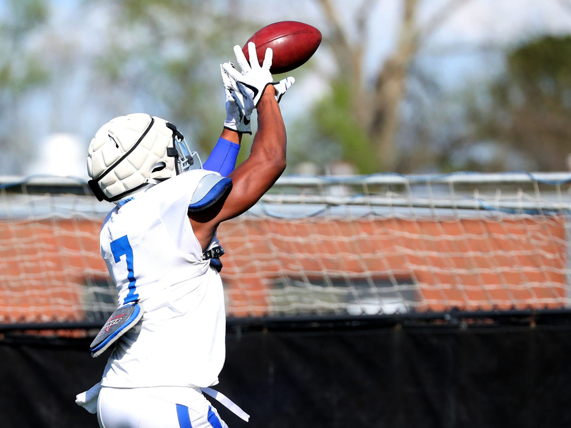MTSU's safety Jovante Moffatt (7) grabs the ball during a drill at MTSU's football practice, in Murfreesboro on Tuesday April 9, 2019.