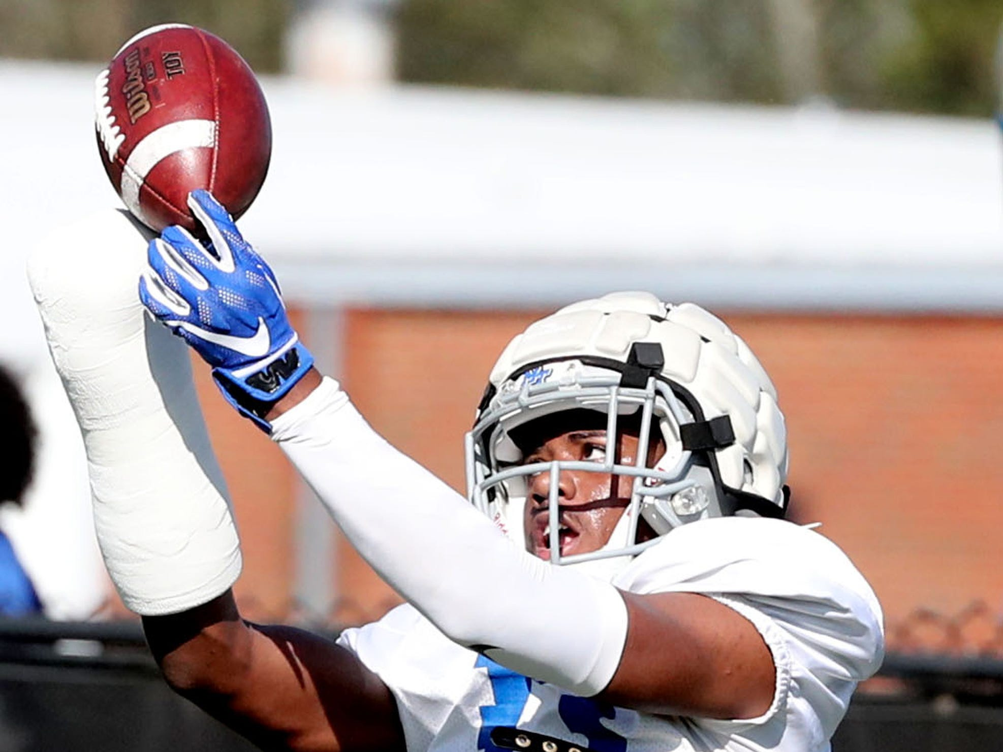 MTSU's safety Decorian Patterson (33) grabs the ball during a drill at MTSU's football practice, in Murfreesboro on Tuesday April 9, 2019.