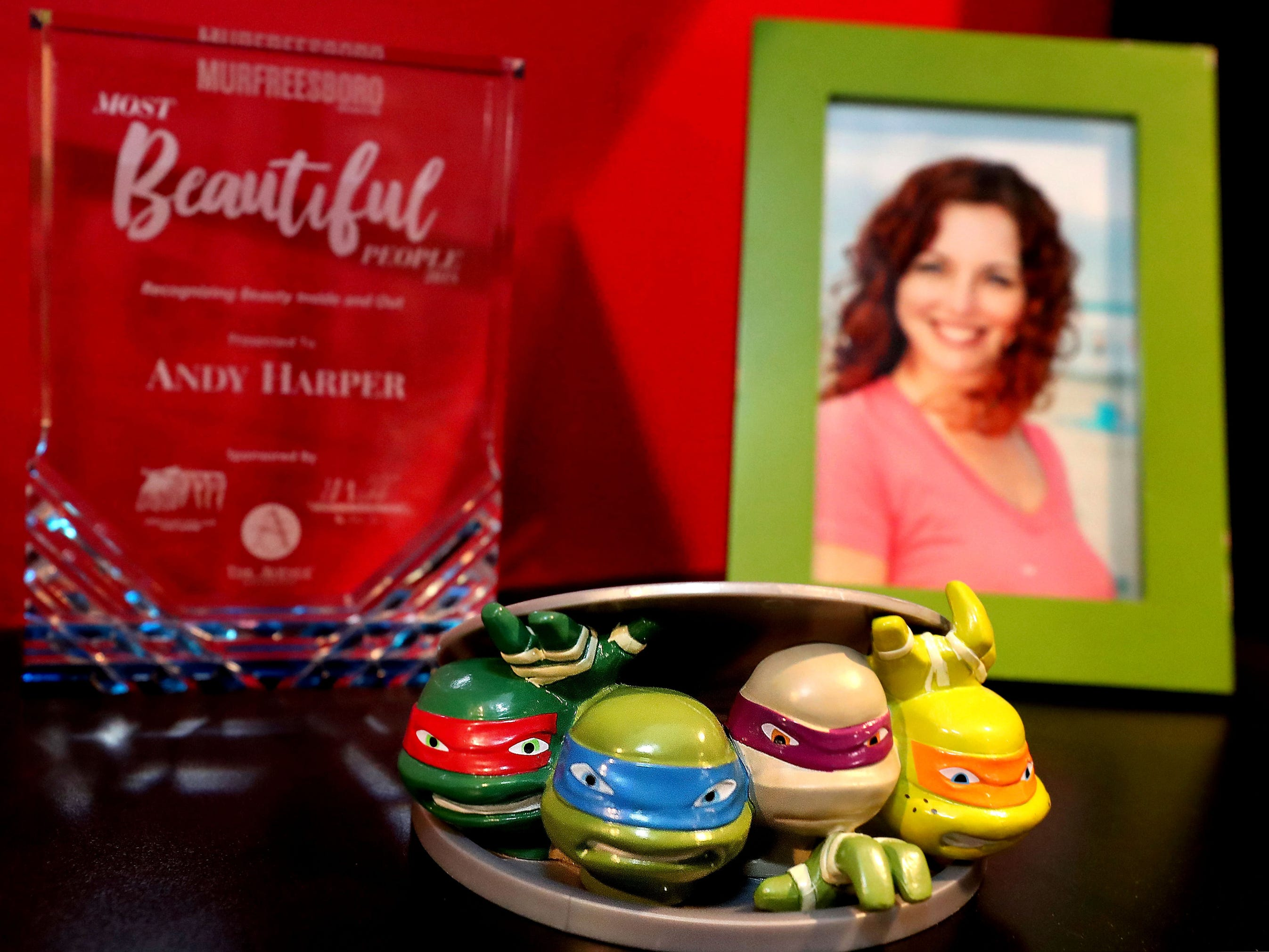 """Andy Harper has done guitar solos for a few episodes of the new """"Rise of the Teenage Mutant Ninja Turtles"""" that is shown on Nickelodeon. A Ninja turtle figure is on the shelf in Harper's studio with his Most Beautiful People award and a photo of his wife Laura Harper."""