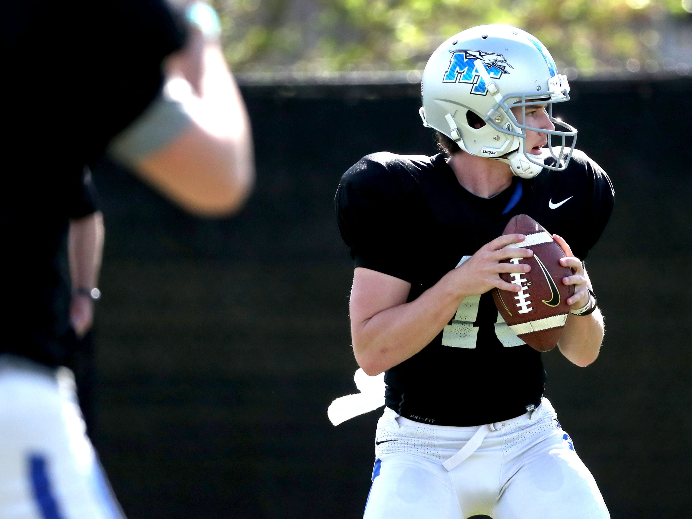 MTSU's quarterback Chase Cunningham (16)) passes the ball during MTSU's football practice, in Murfreesboro on Tuesday April 9, 2019.