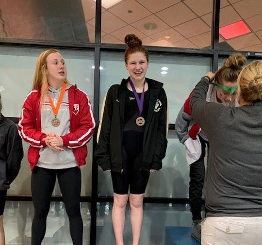 Central Magnet's Kailey Orr (center) is the DNJ's 2018-19 all-area girls swimmer of the year.