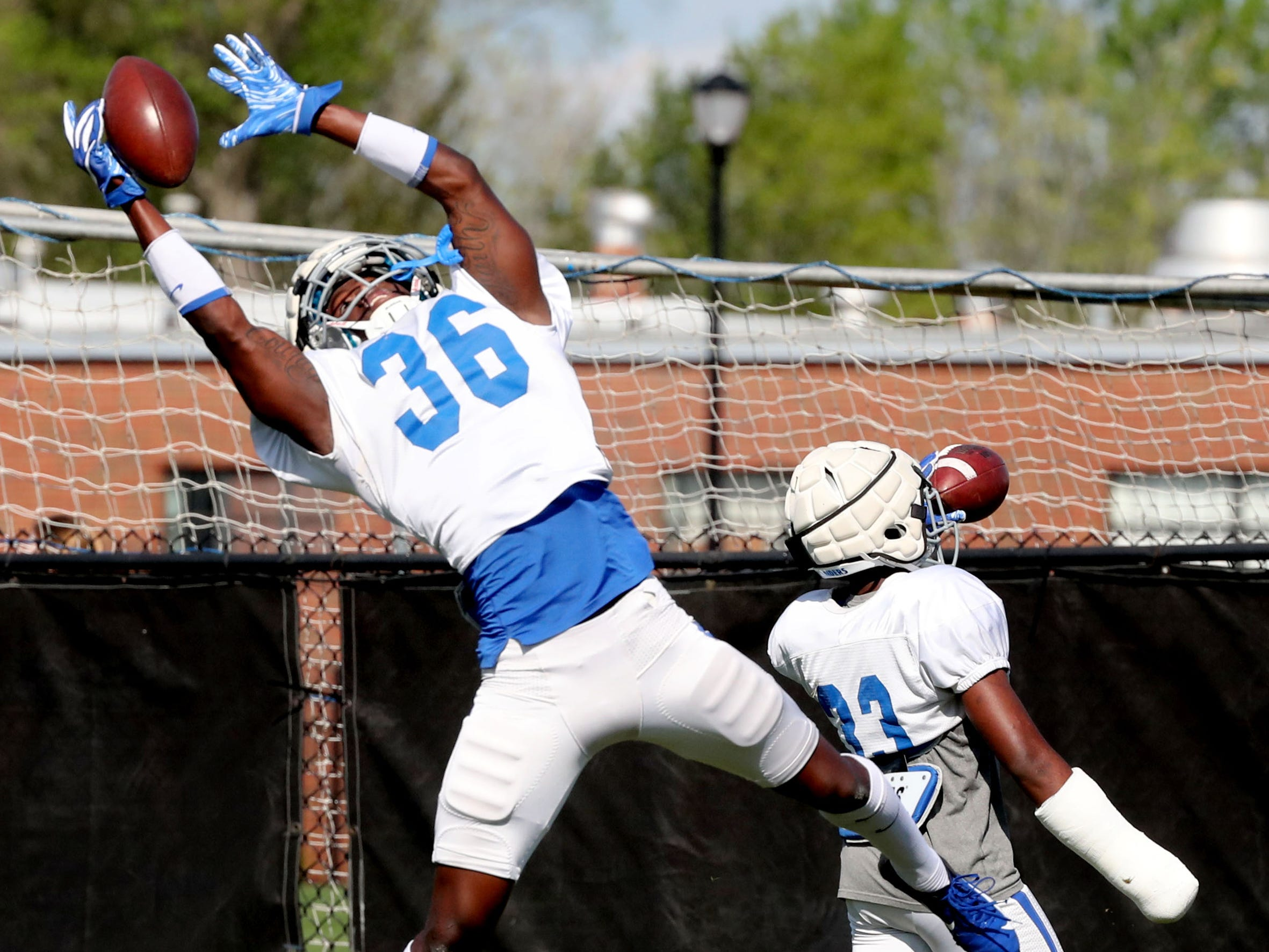 MTSU's defensive back Kamau Farrell-Burke (36) grabs the ball during a drill at MTSU's football practice, in Murfreesboro on Tuesday April 9, 2019.