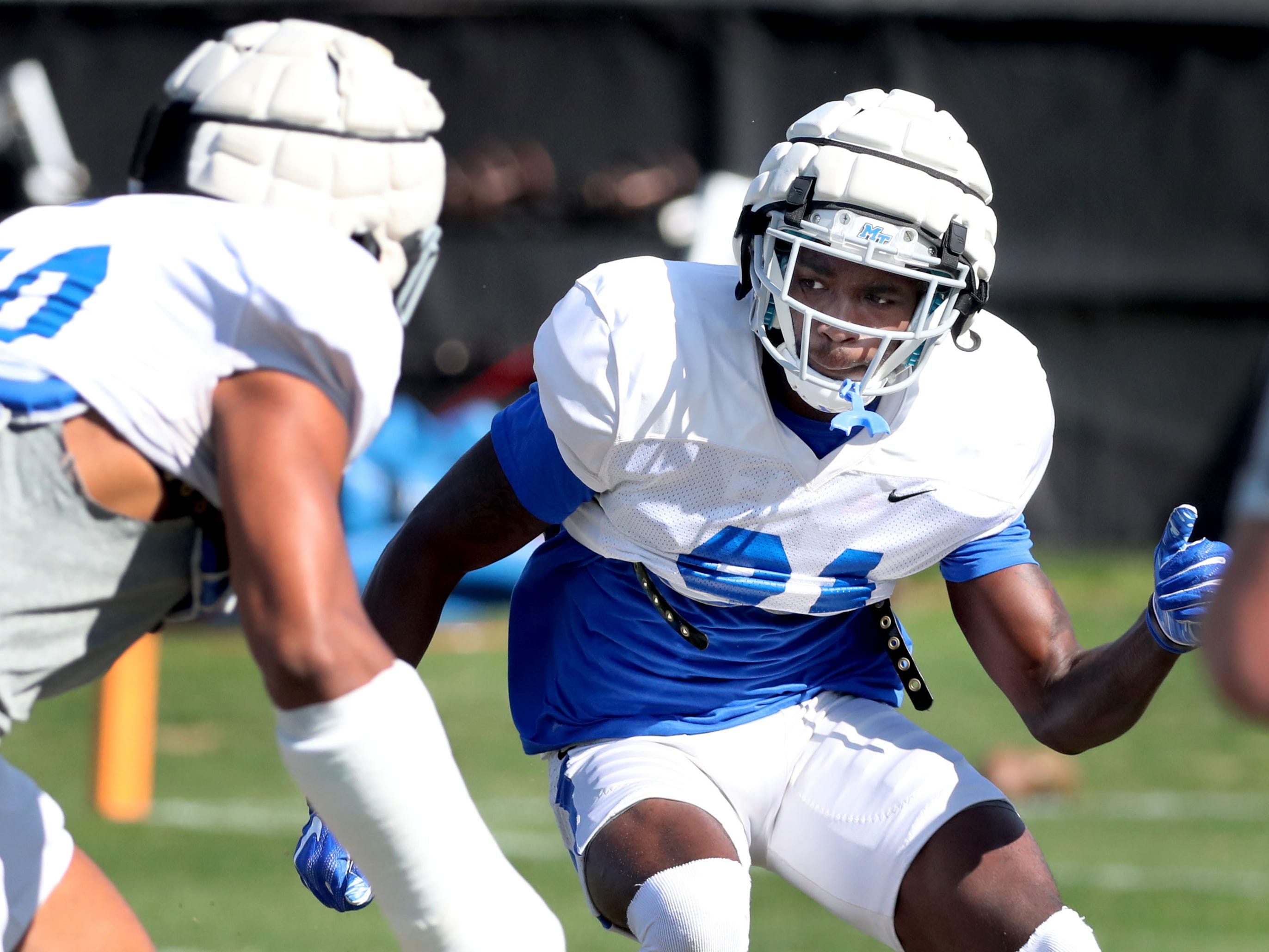 MTSU's cornerback Justin Brown (31) runs a drill during MTSU's football practice as MTSU's linebacker Jarek Campbell (10) moves in on Tuesday April 9, 2019.