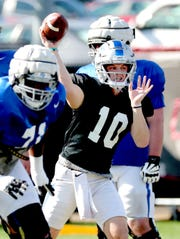 MTSU's quarterback Asher O'Hara (10) passes the ball during MTSU's football practice, in Murfreesboro on Tuesday April 9, 2019.