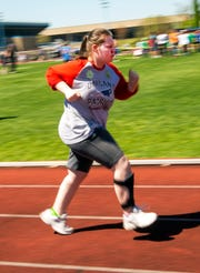 Brittany, a student at Oakland, leads the pack as she speeds down the track in her heat race during the Special Olympics at MTSU.