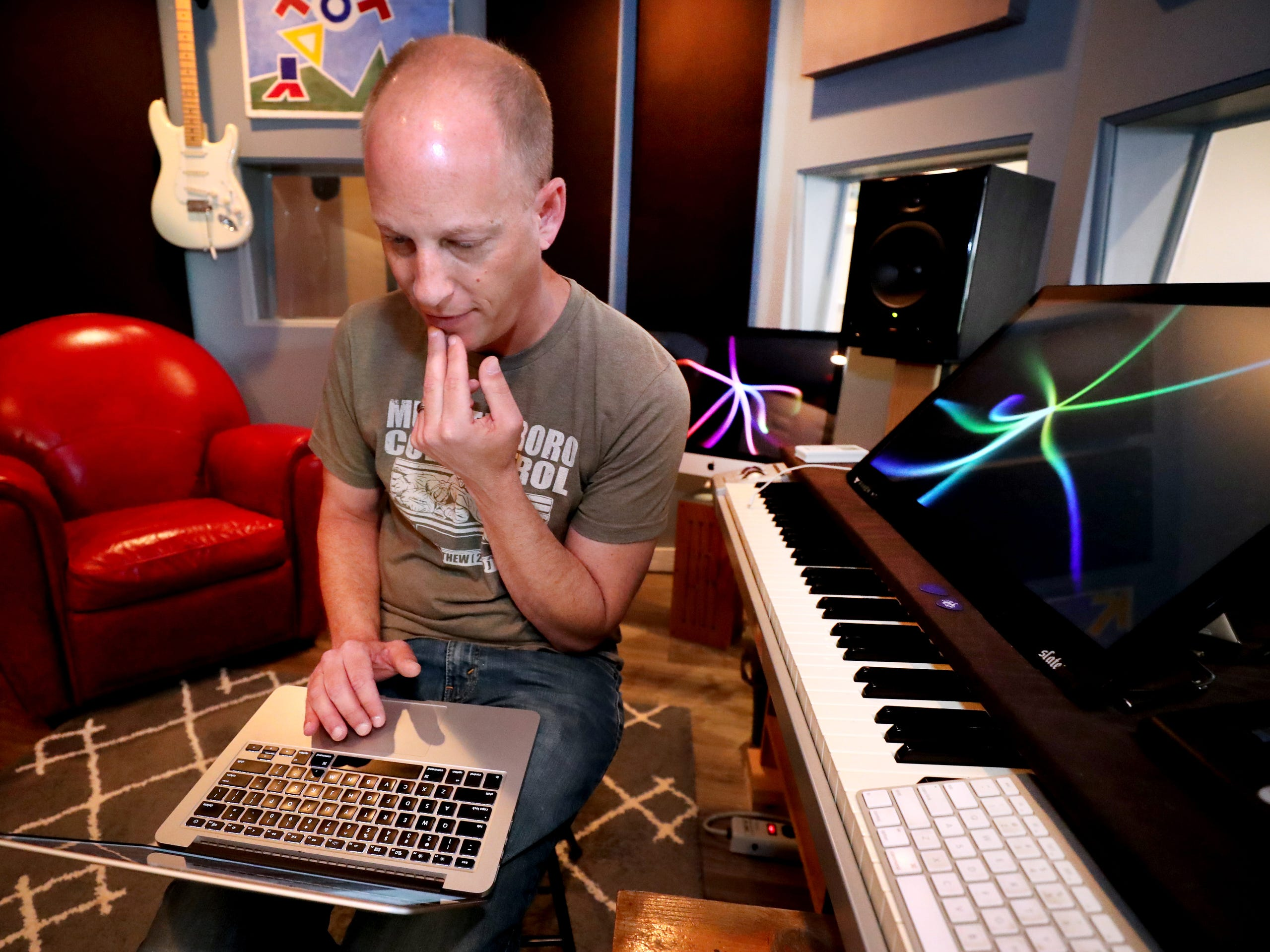 Andy Harper pulls up some of the projects that he has worked on in the past in his studio Limitedwave Recordings on Wednesday April 10, 2019.