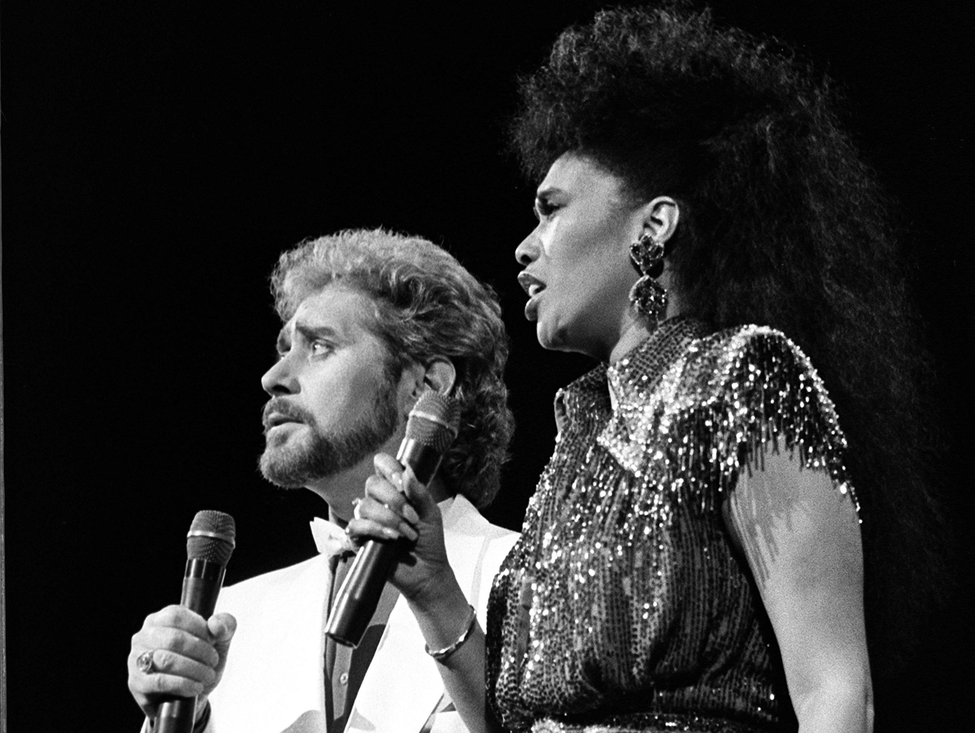 """Earl Thomas Conley, left, and R&B and pop star Anita Pointer perform their hit """"Too Many Times"""" during the CMA Awards at the Grand Ole Opry House on Oct. 13, 1986."""