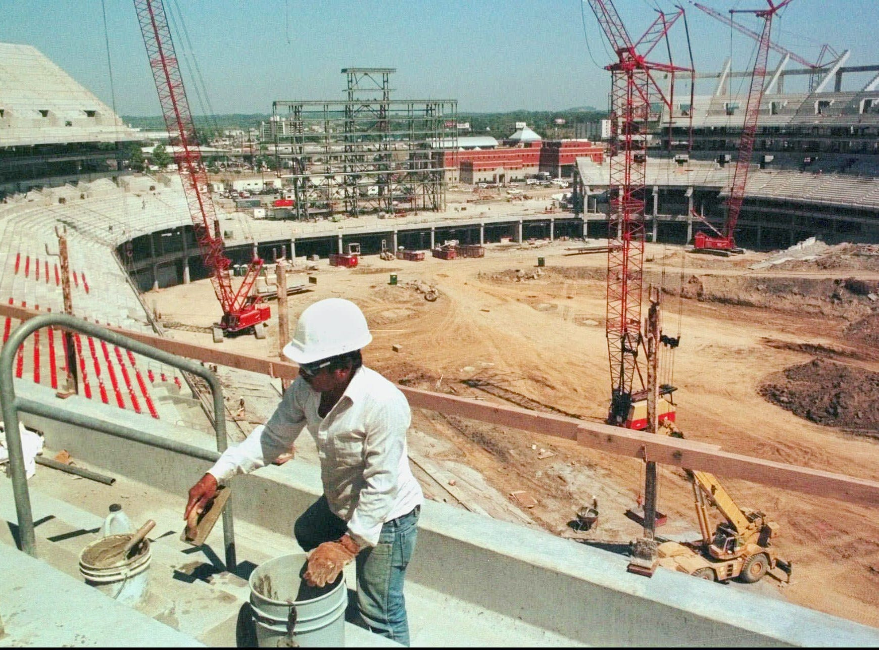 Construction worker Ramiro Noguera works on concrete steps in the Tennessee Oilers' new 67,000-seat stadium in Nashville Sept. 3, 1998. A place to call home is something the team is looking forward to. When the Oilers start the 1999 season in the yet-to-be-named stadium, it will be their fourth home field in four years.