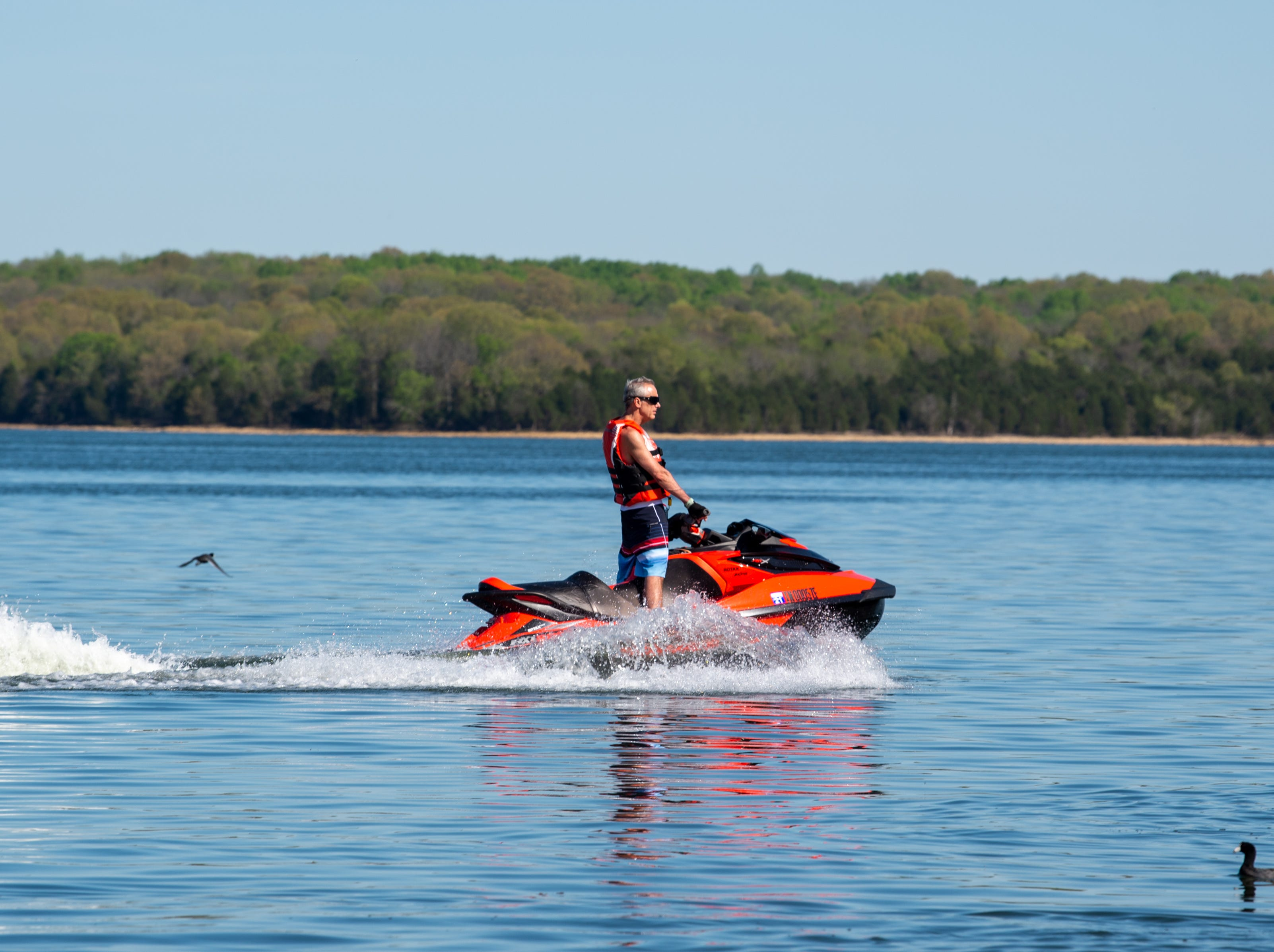 A person rides a jet ski at Percy Priest Lake Wednesday, April 10, 2019, in Nashville, Tenn.
