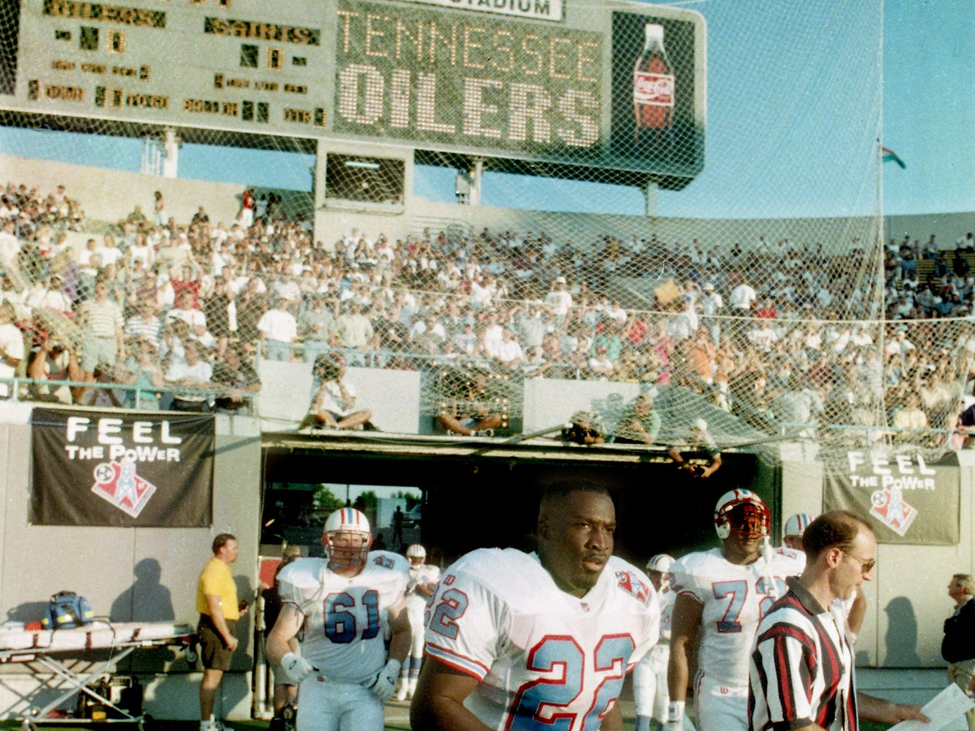 Tennessee Oilers players Mike Archie (22), Sean Wells (61) and Brad Hopkins (72) walks on to the field for their pre-season game with New Orleans Saints at Liberty Bowl Memorial Stadium in Memphis Aug. 2, 1997. It is the Oilers very first game in their new state.