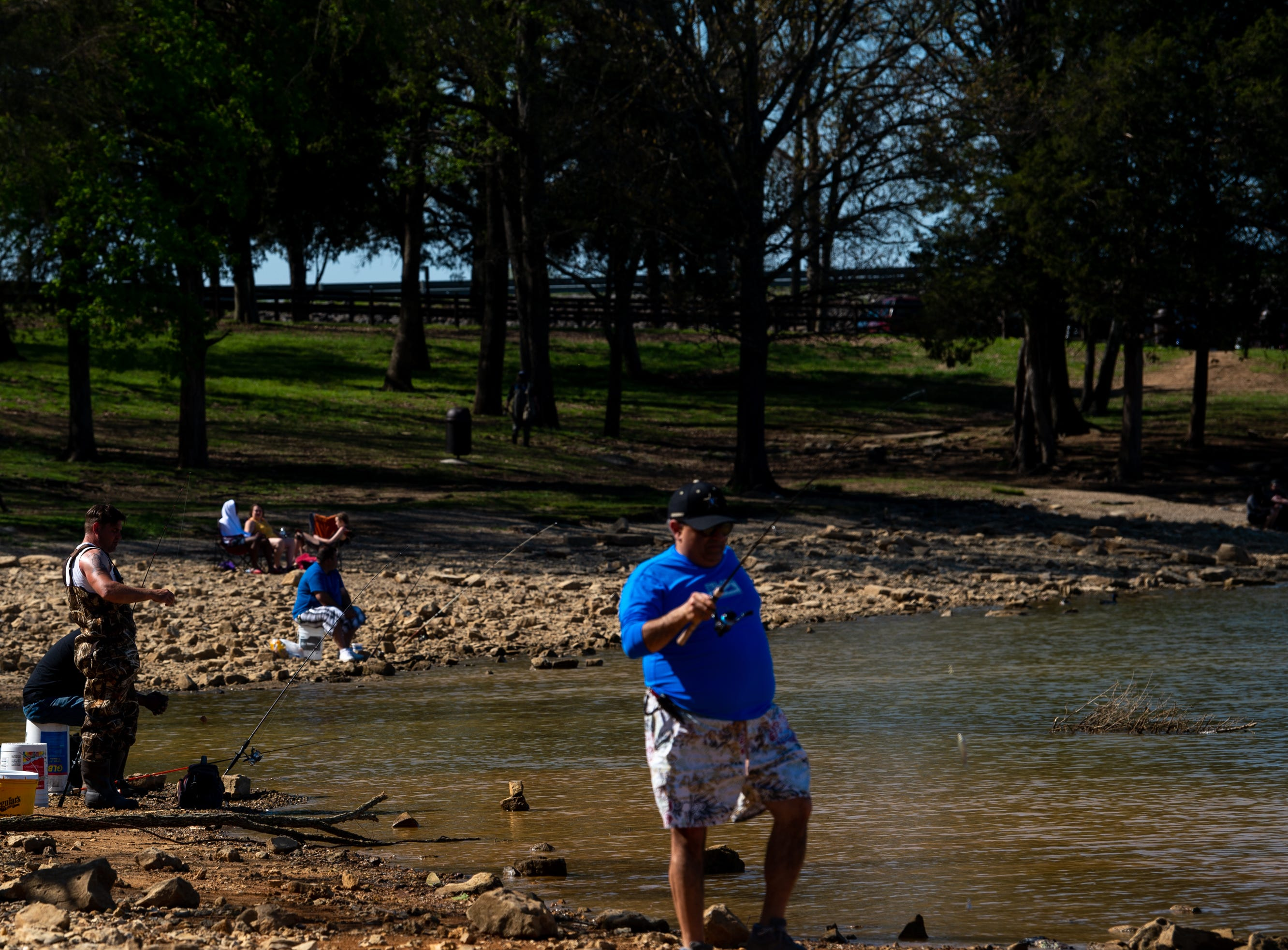 People fish at Percy Priest Lake Wednesday, April 10, 2019, in Nashville, Tenn.