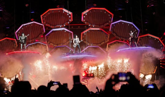 Gene Simmons, left, Paul Stanley, center, and Tommy Thayer of the rock band KISS perform during their concert at Bridgestone Arena Tuesday, April 9, 2019, in Nashville, TN.