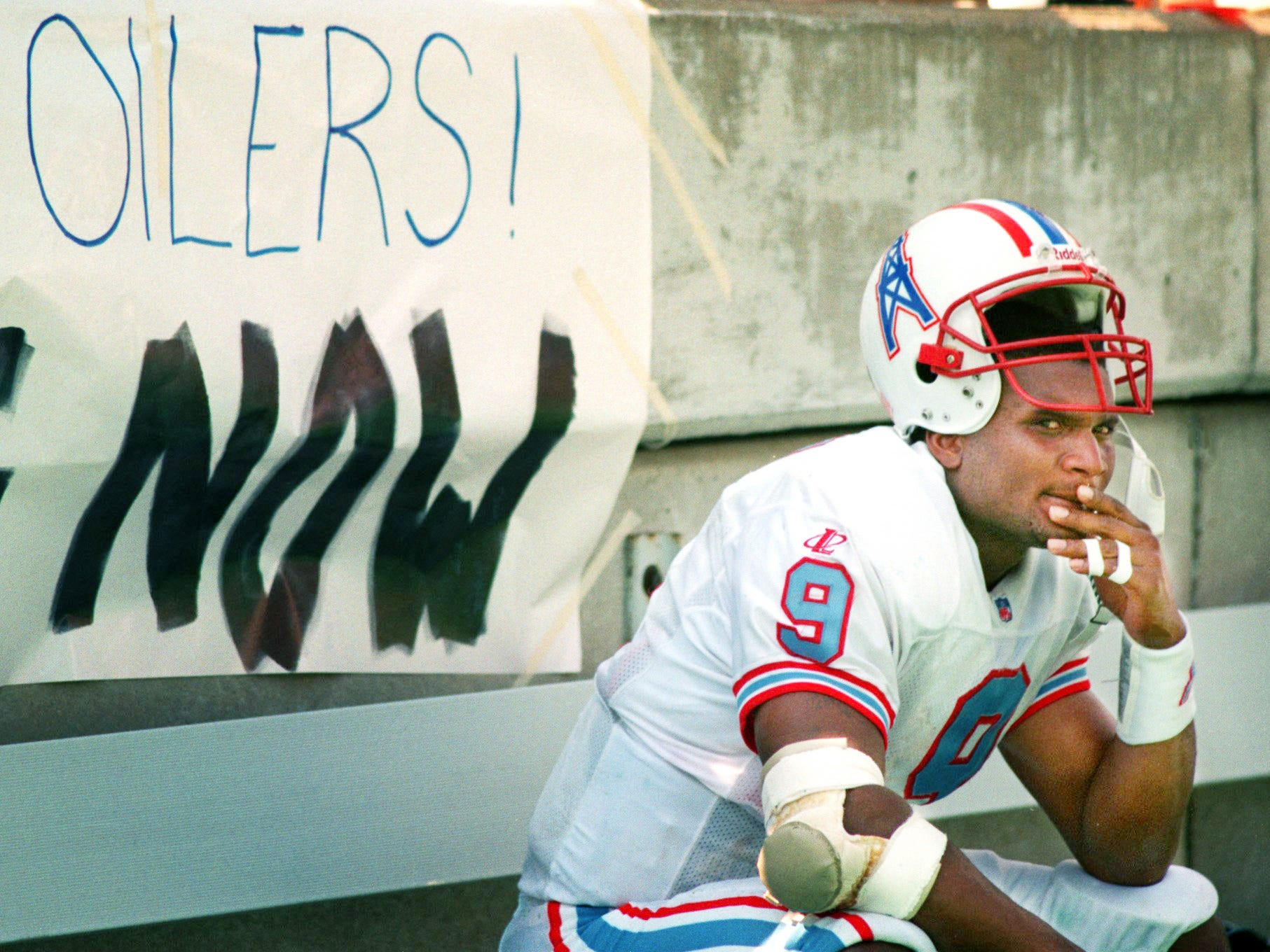 Tennessee Oilers Quarterback Steve McNair sits alone on the bench after the Oilers lost the to the San Diego Chargers 13-7 in the season home opener at Vanderbilt University's Dudley Field Sept. 13, 1998.