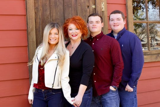 Camile Caraway poses for a photo with her children Savannah, Riley and Parker. She's organizing a suicide awareness fundraiser in Parker's honor in Hendersonville on Tuesday, April 30.