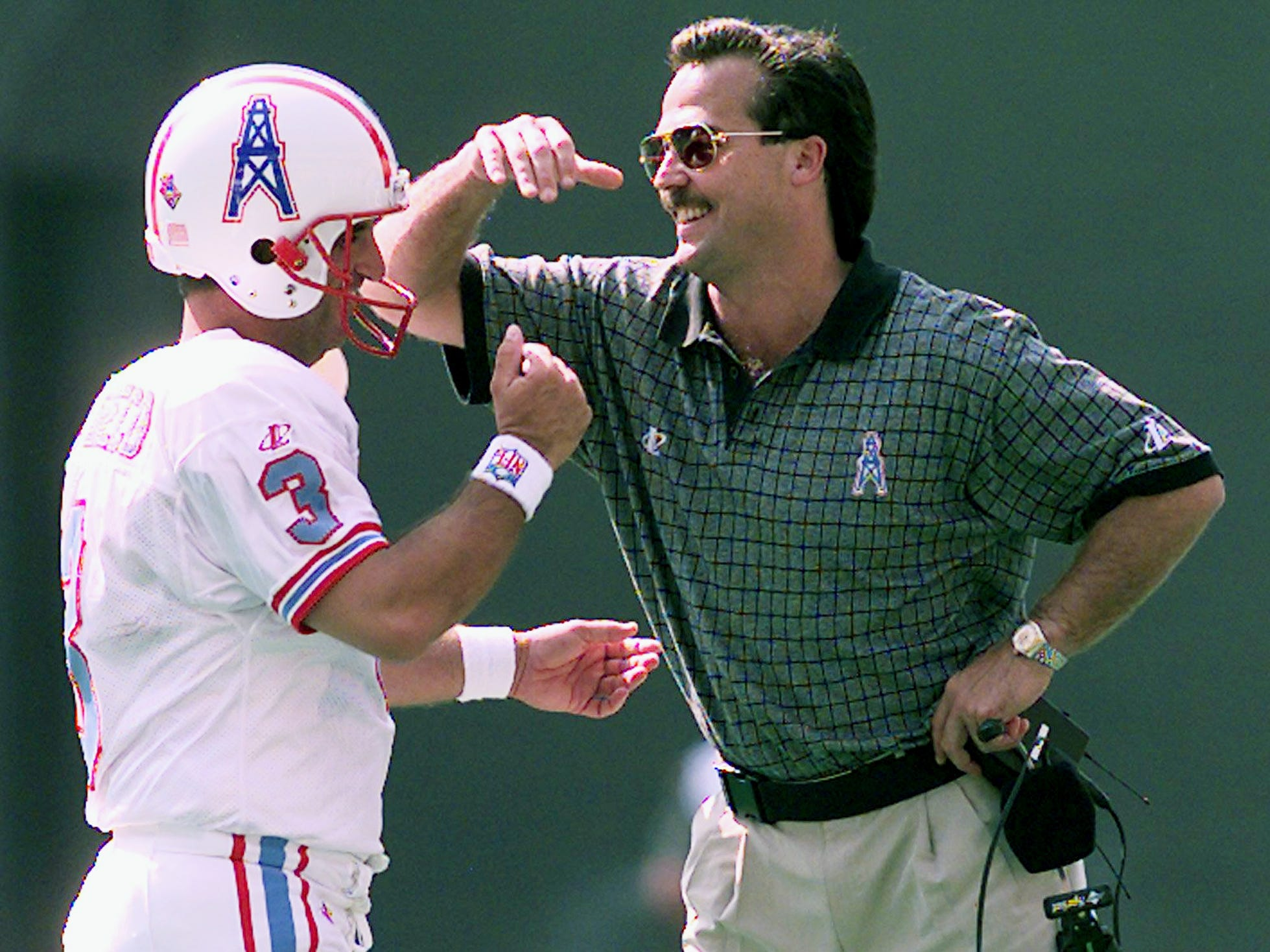 Tennessee Oilers head coach Jeff Fisher, right, congratulates kicker Al Del Greco after making a field goal against Cincinnati Bengals. The Oilers went on to a 23-14 road victory Sept. 6, 1998.