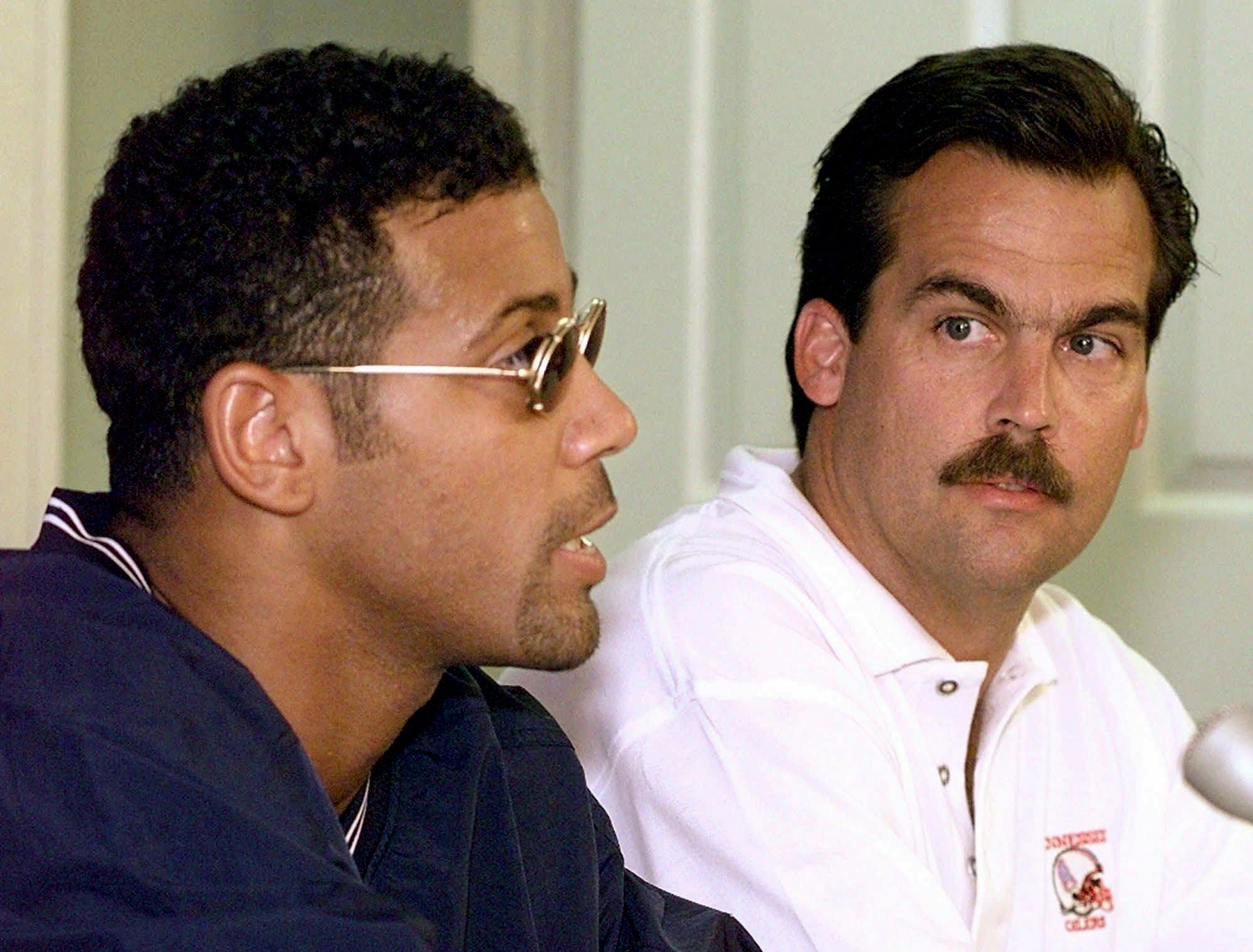 Tennessee Oilers coach Jeff Fisher, right, listens as Blaine Bishop answers questions after signing a six-year contract with the team Aug. 27, 1997 in Nashville. Bishop, a two-time Pro Bowler, held out of training camp and the first week of practice looking for a long-term deal.