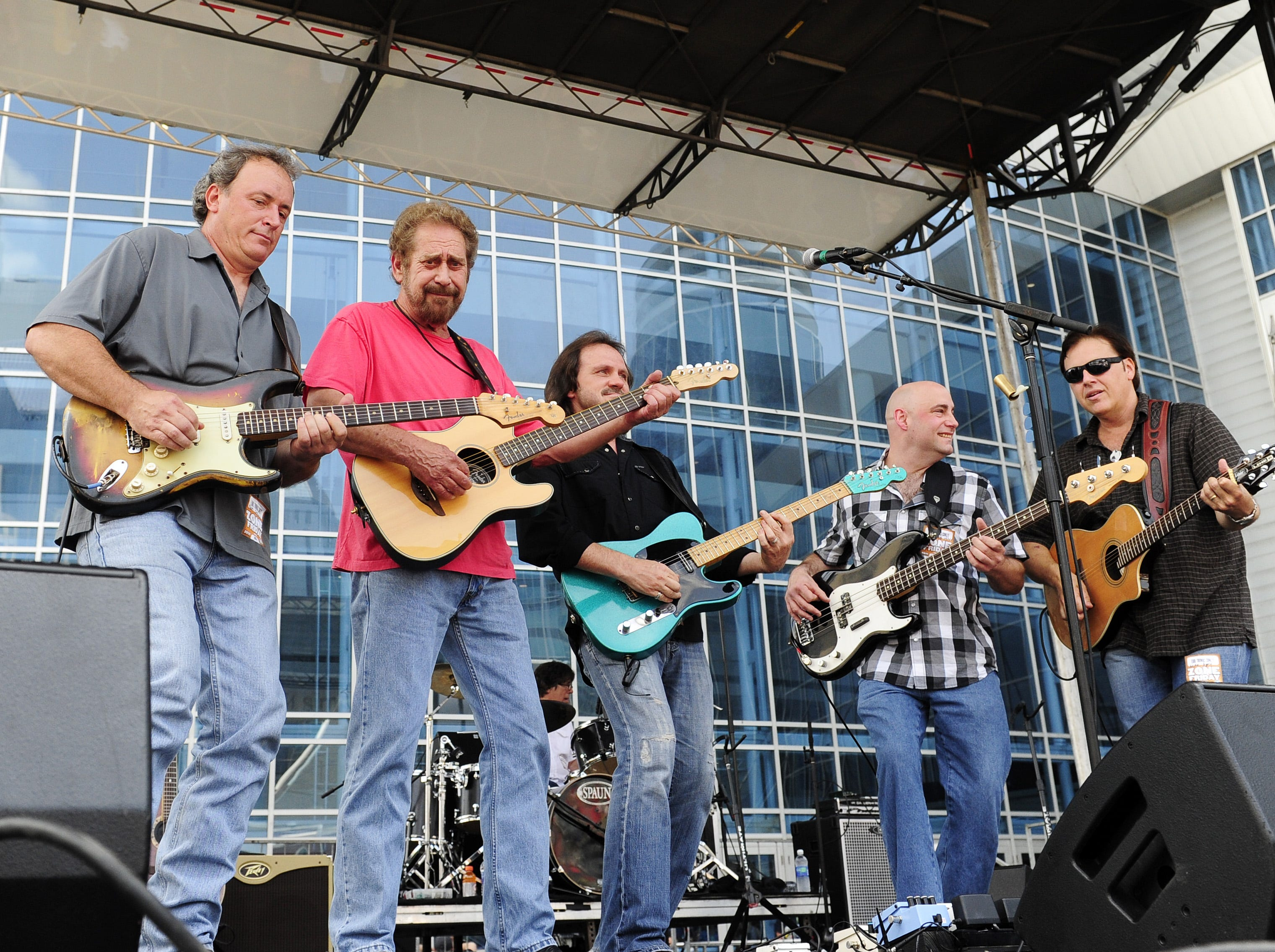 Earl Thomas Conley, second from left, performs during the CMA Music Festival in downtown Nashville on June 10, 2011.