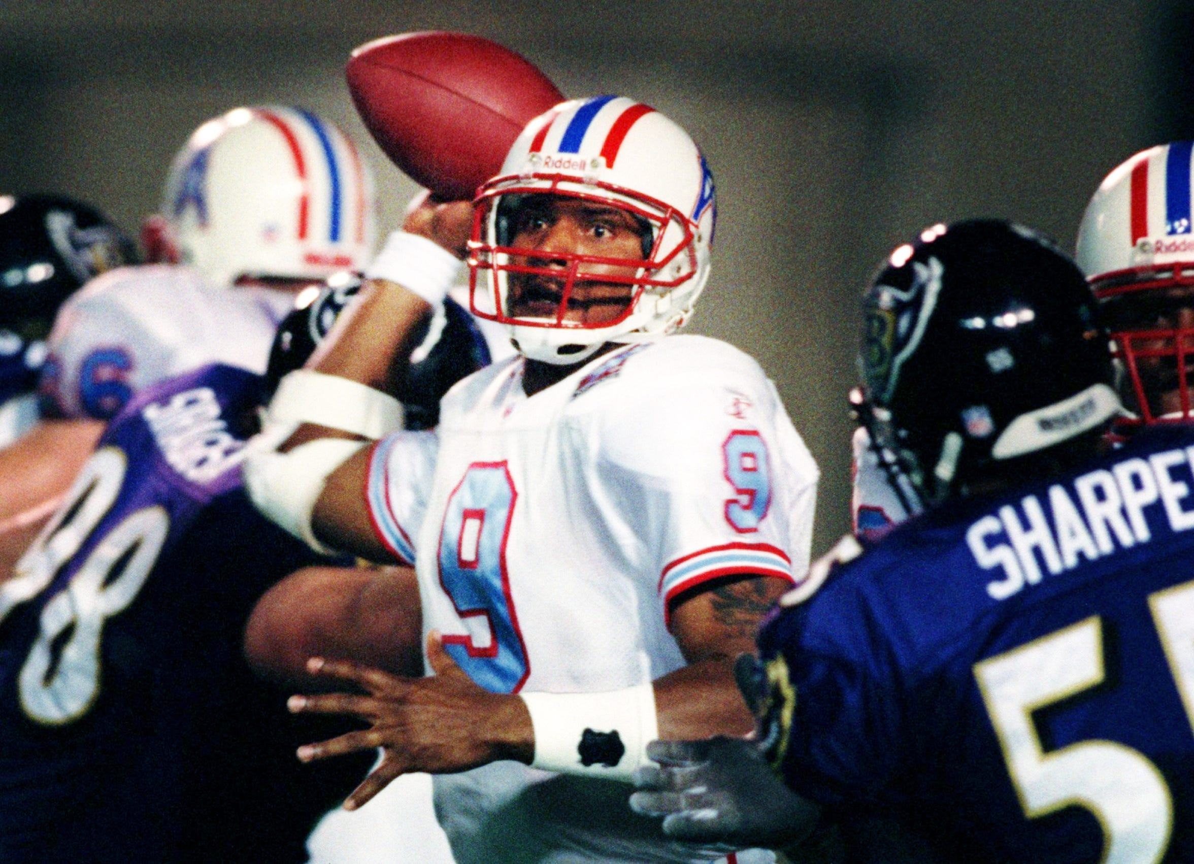 Tennessee Oilers quarterback Steve McNair (9) steps up in the pocket to throw against the defensive pressure of the Baltimore Ravens. The Oilers won the game 16-14 at Vanderbilt Stadium Dec. 6, 1998.