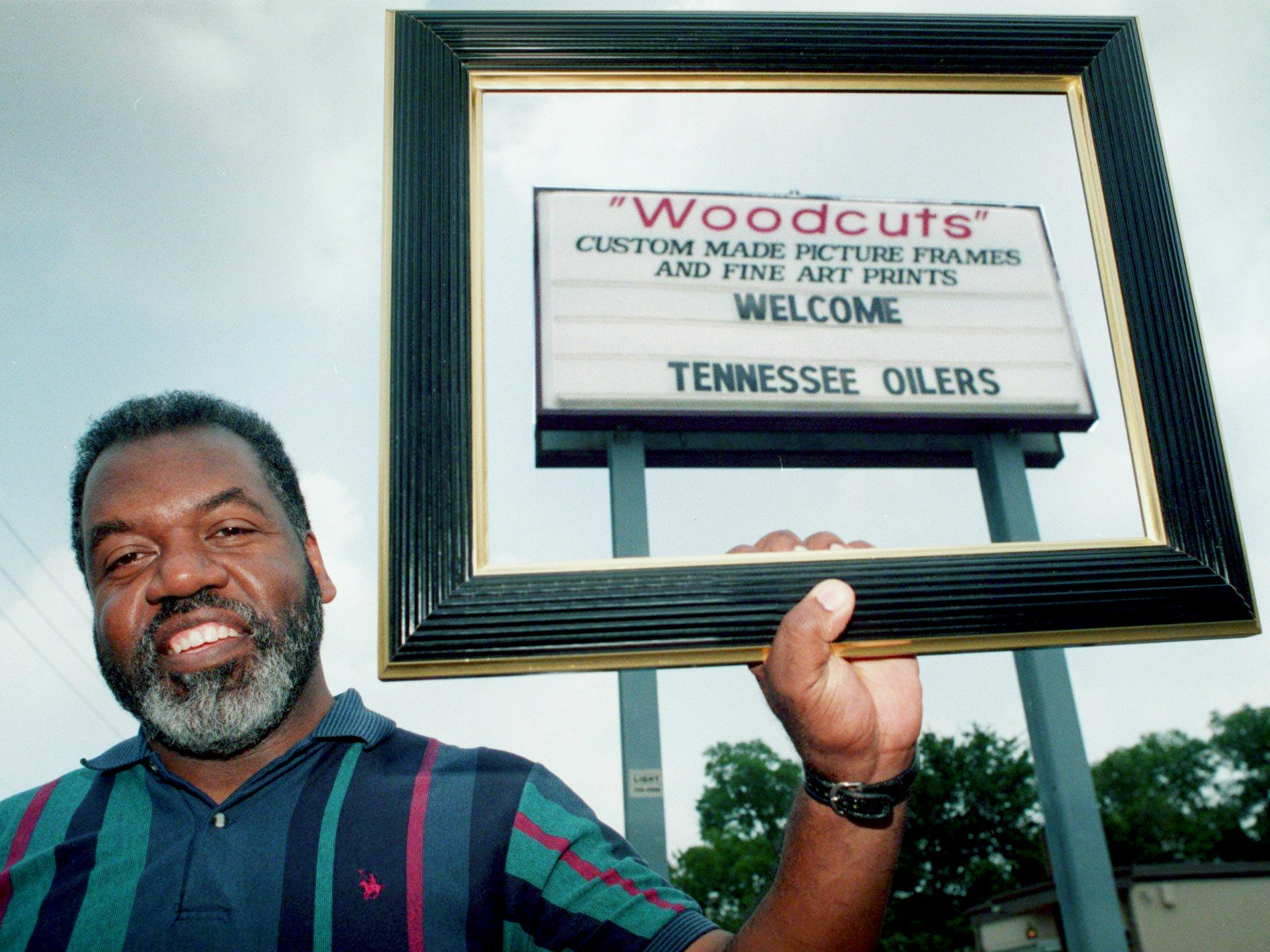 Nathaniel Harris, owner of Woodcuts on Jefferson Street, is one of several businesses attempting to attract business from the Tennessee Oilers July 23, 1997.